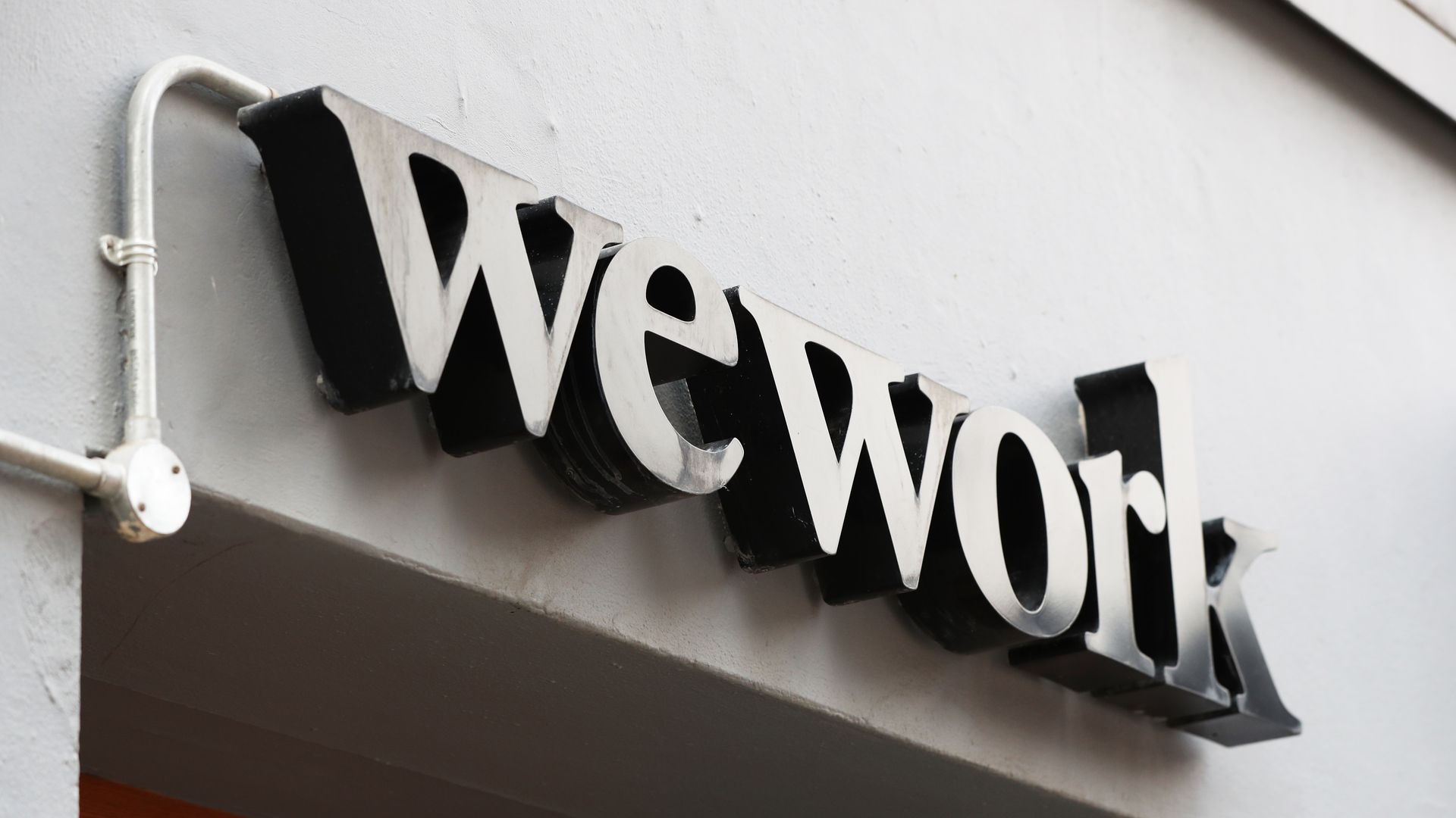 The WeWork sign outside of a community office