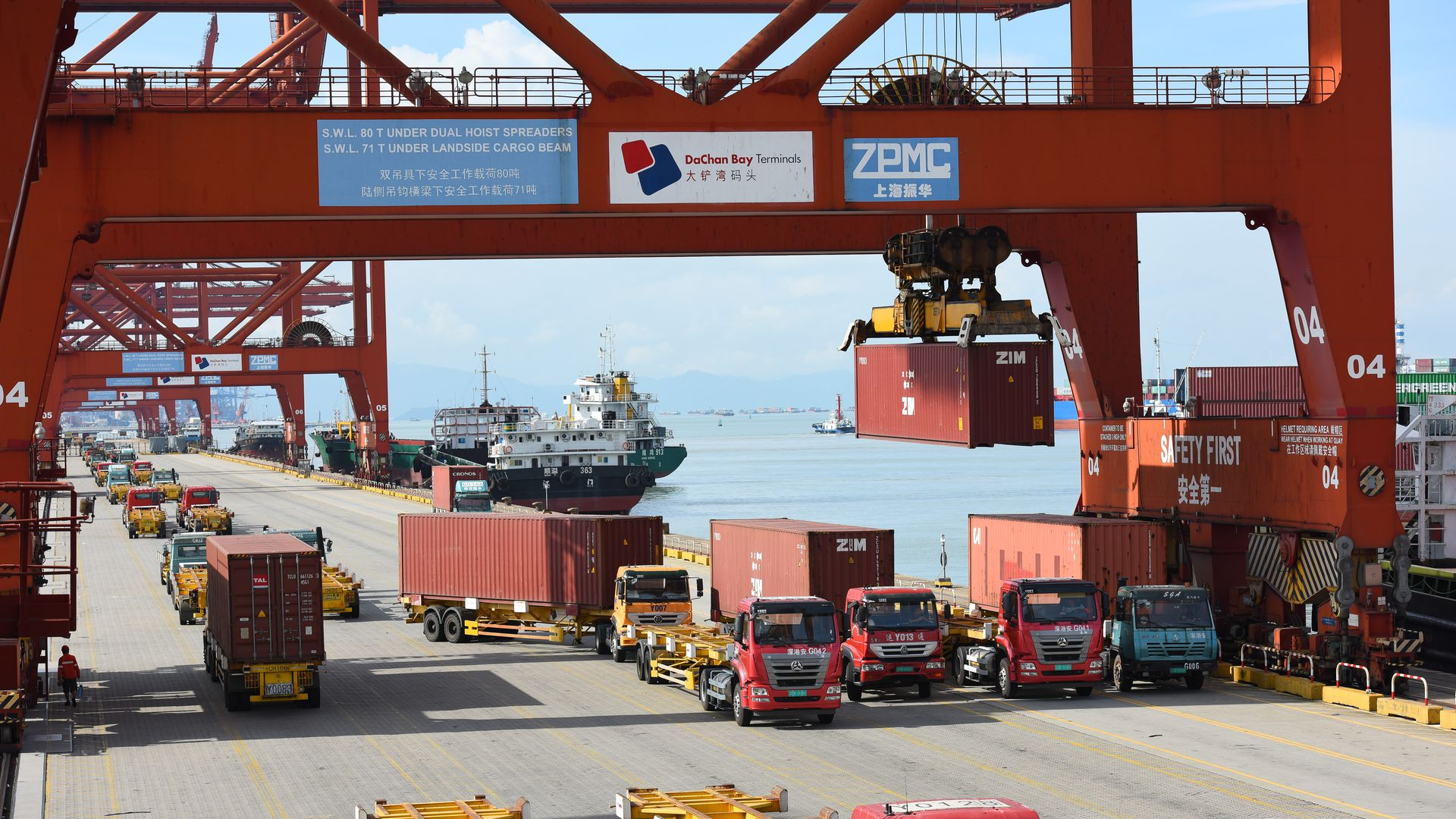 Trucks transport containers at Dachan Bay Terminals in Shenzhen, Guangdong Province of China. Photo: VCG