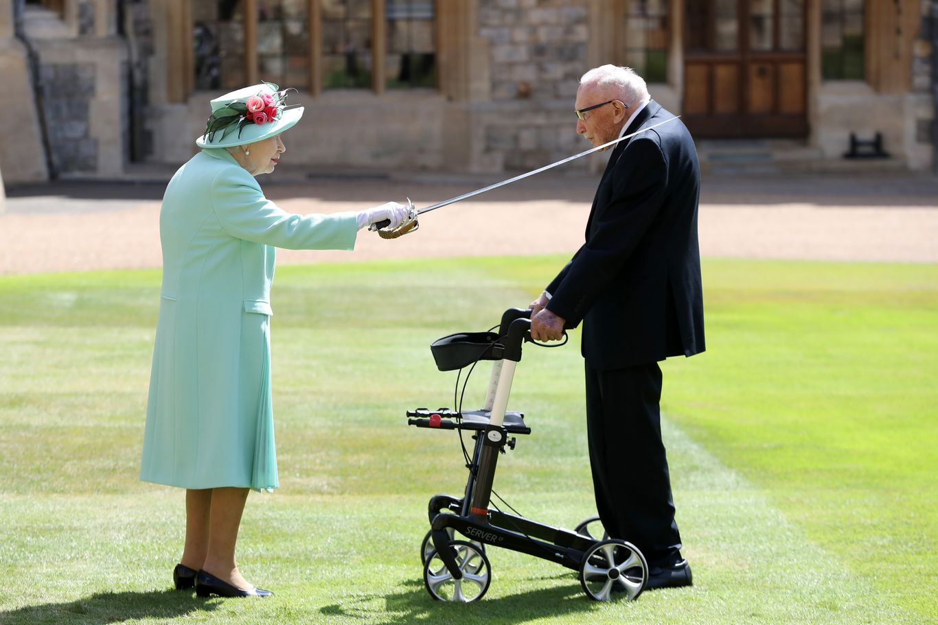 Queen knights 100-year-old who raised more than $40 million for U.K.'s National Health Service thumbnail