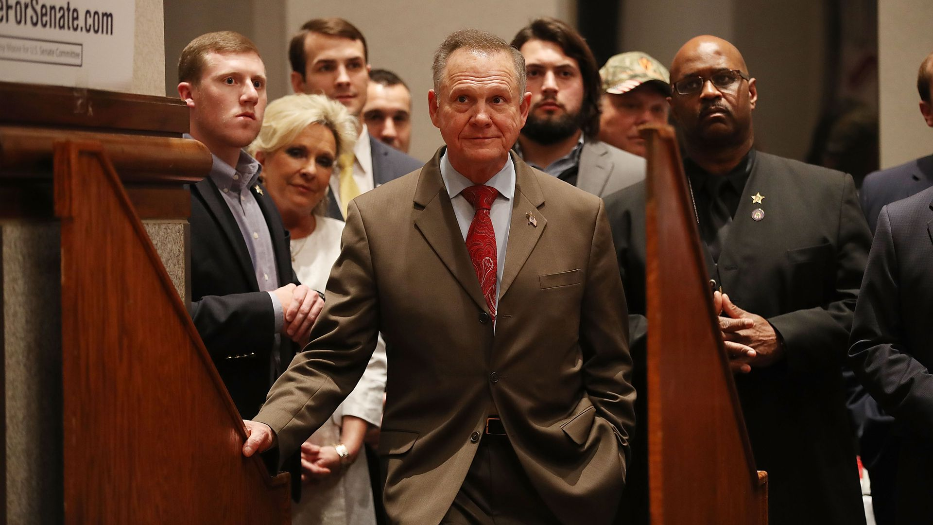 Roy Moore with a group behind him.