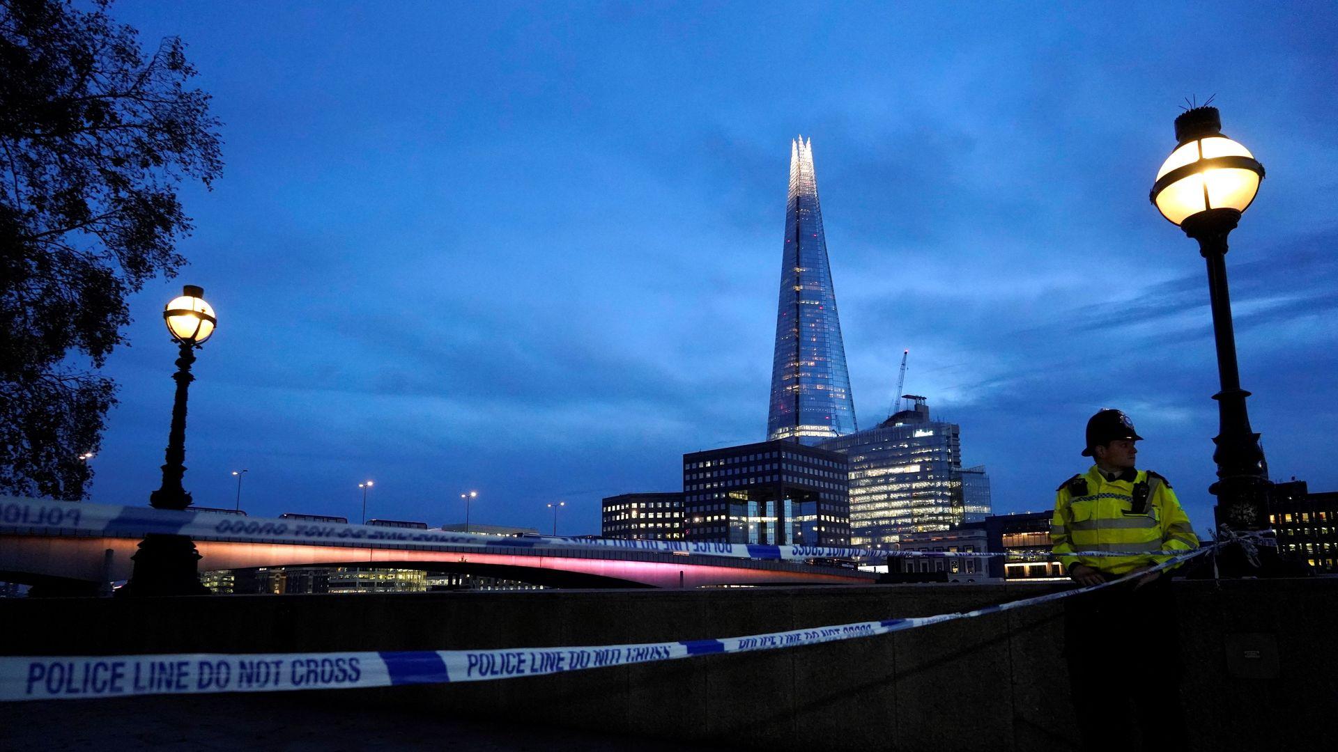 A police officers patrols near London Bridge in London, on November 30