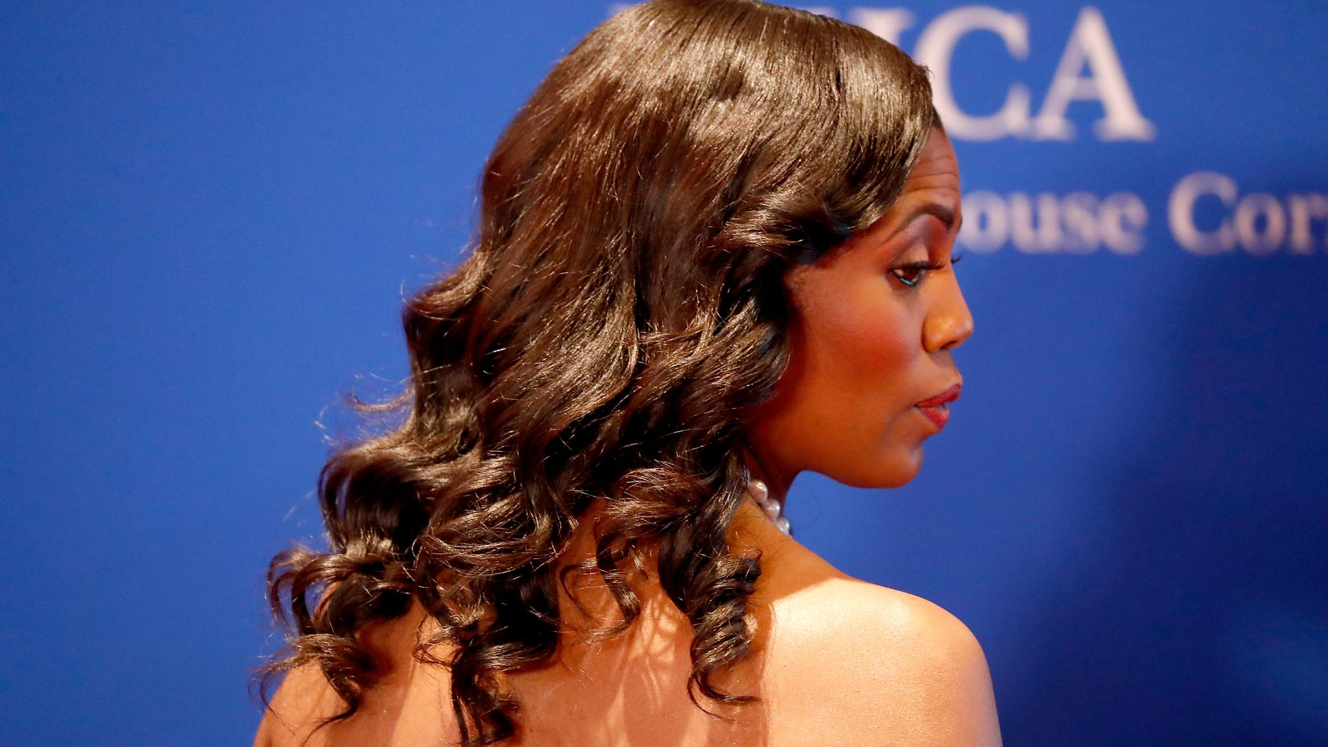 This is a photo of Omarosa Manigault on the White House Correspondents Dinner red carpet