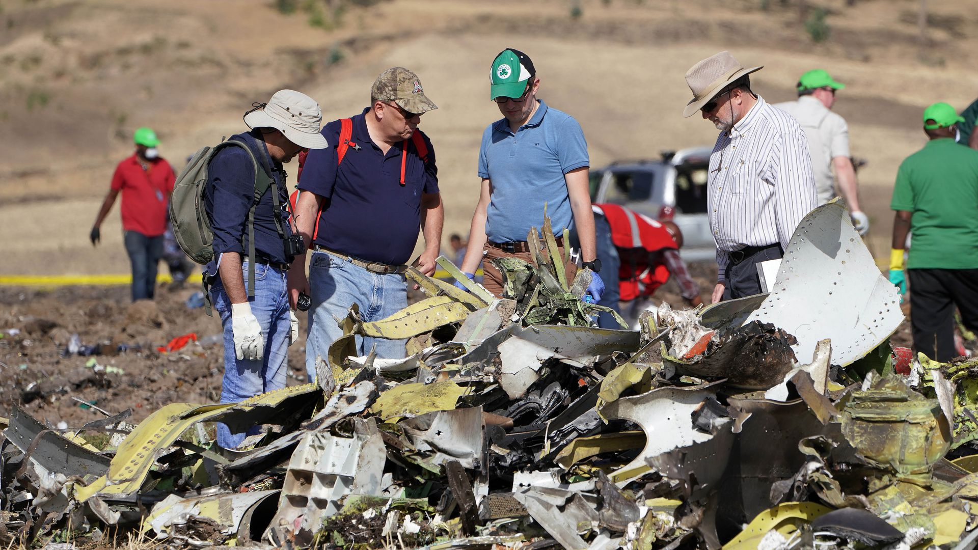 Investigators with the U.S. National Transportation and Safety Board look over debris at the crash site of Ethiopian Airlines Flight ET 302.
