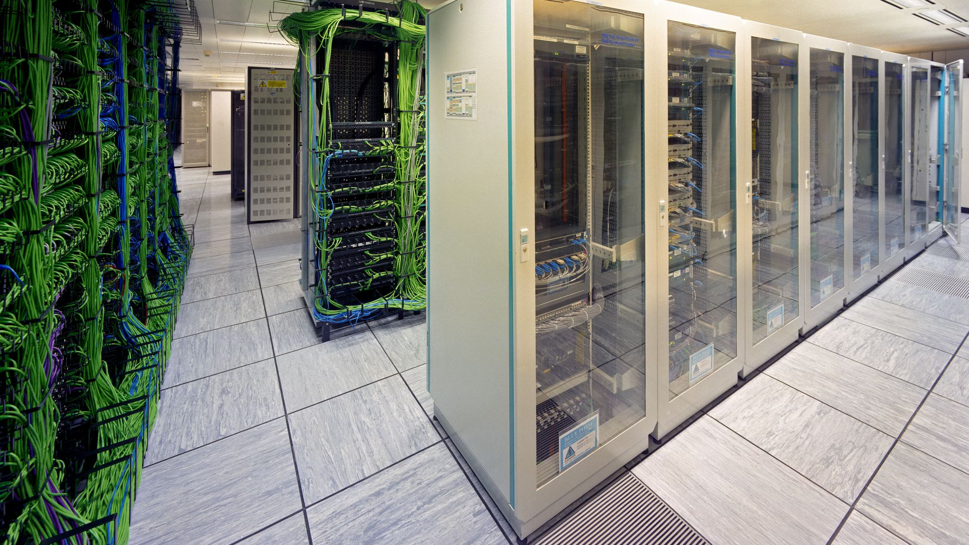 Data center green wires on left white cases on right