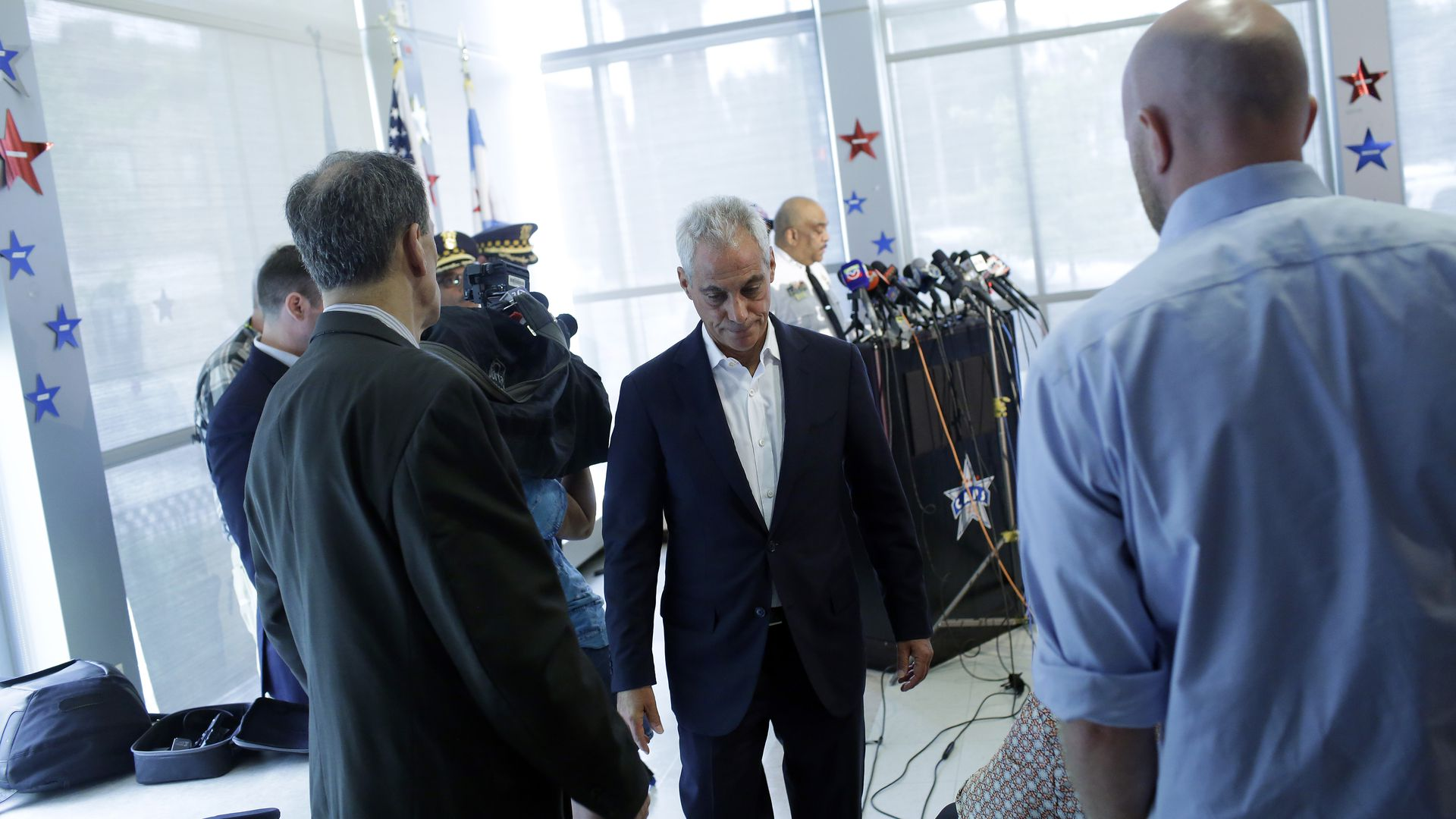 Rahm Emanuel with his head down.