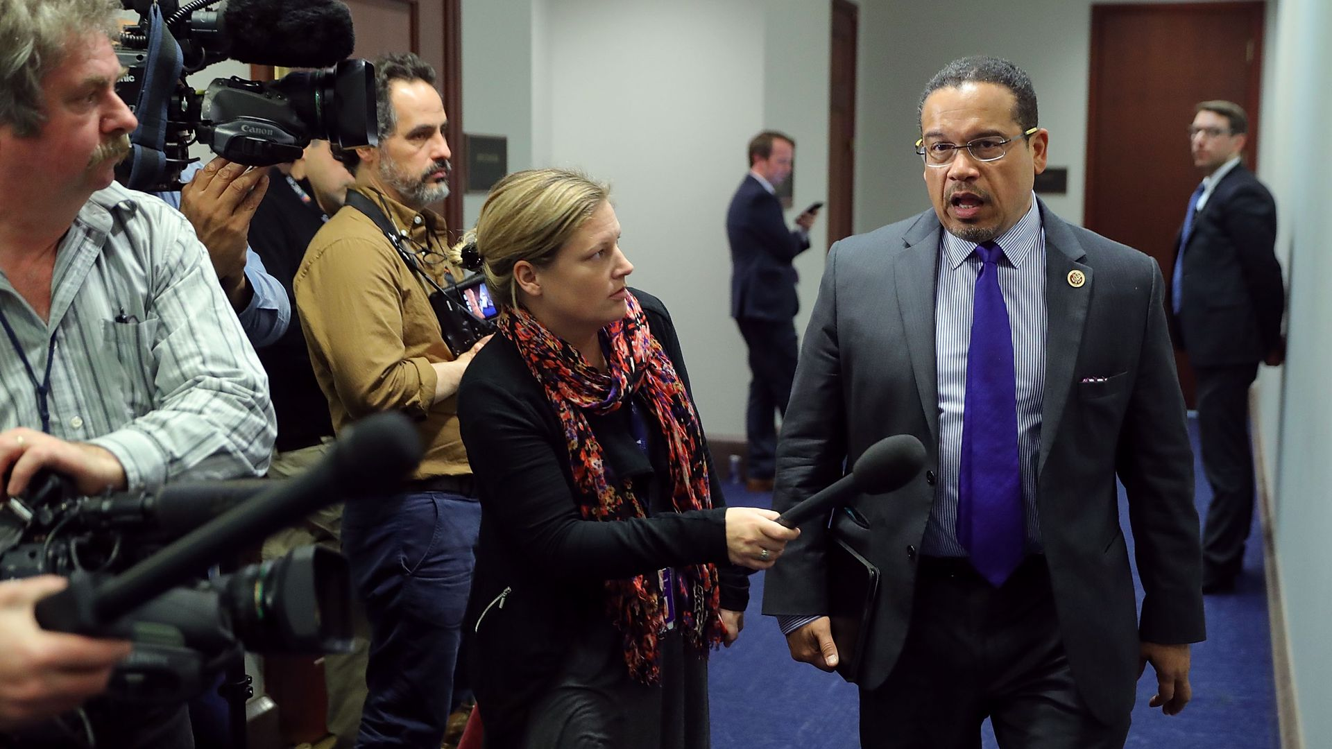 Democratic National Committee Deputy Chair Rep. Keith Ellison (D-MN) (R) talks to reporters