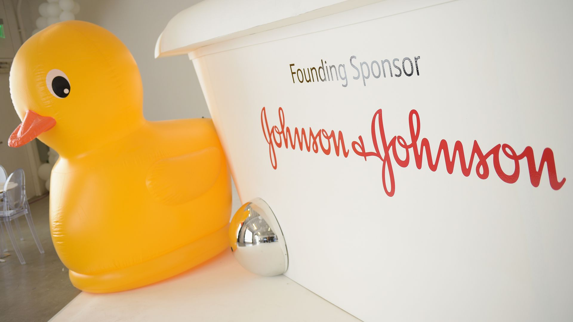 The Johnson & Johnson sign next to a rubber duck.