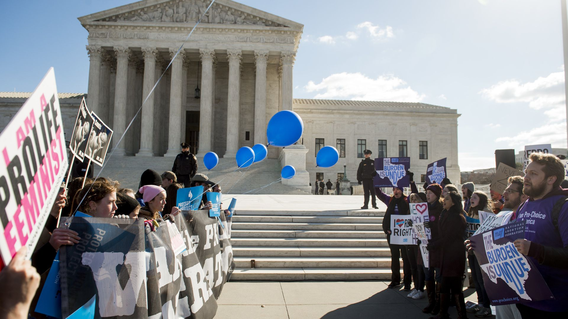 Supporters of legal access to abortion, as well as anti-abortion activists, rally outside the Supreme Court in Washington, DC.