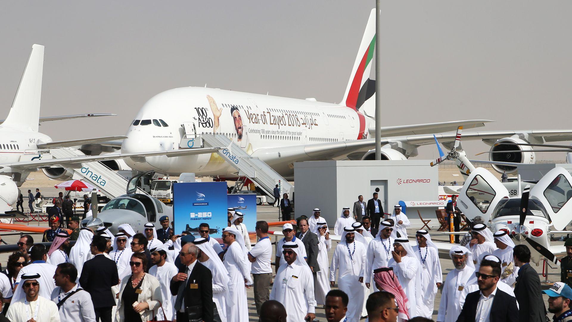 A plane on crowded tarmac