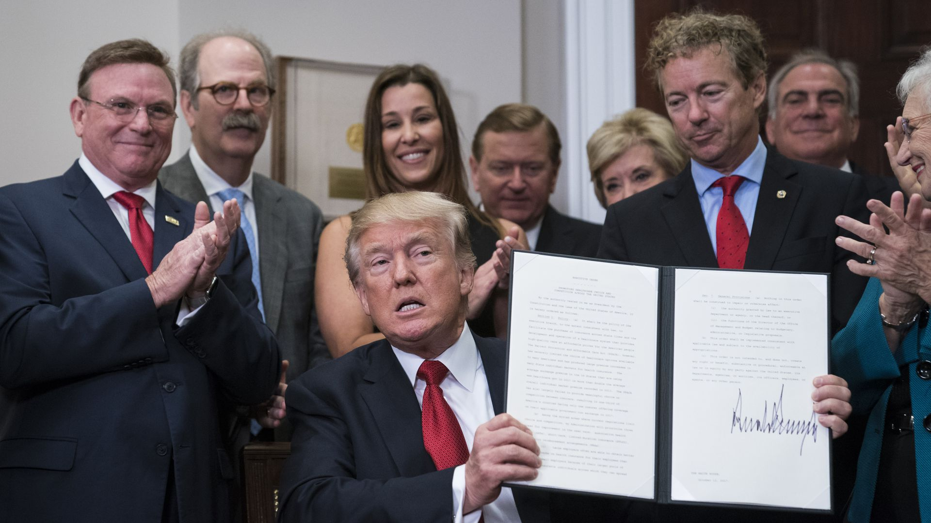 President Trump displays his executive order on health care