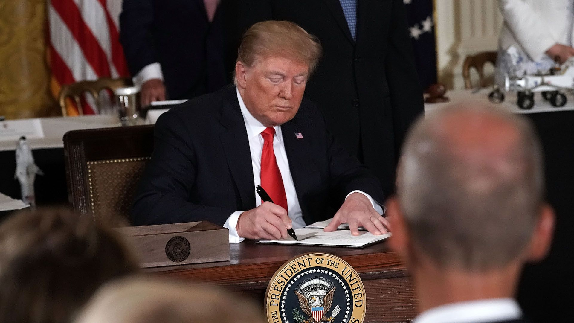 President Donald Trump signs an executive order on the Space Force in June.