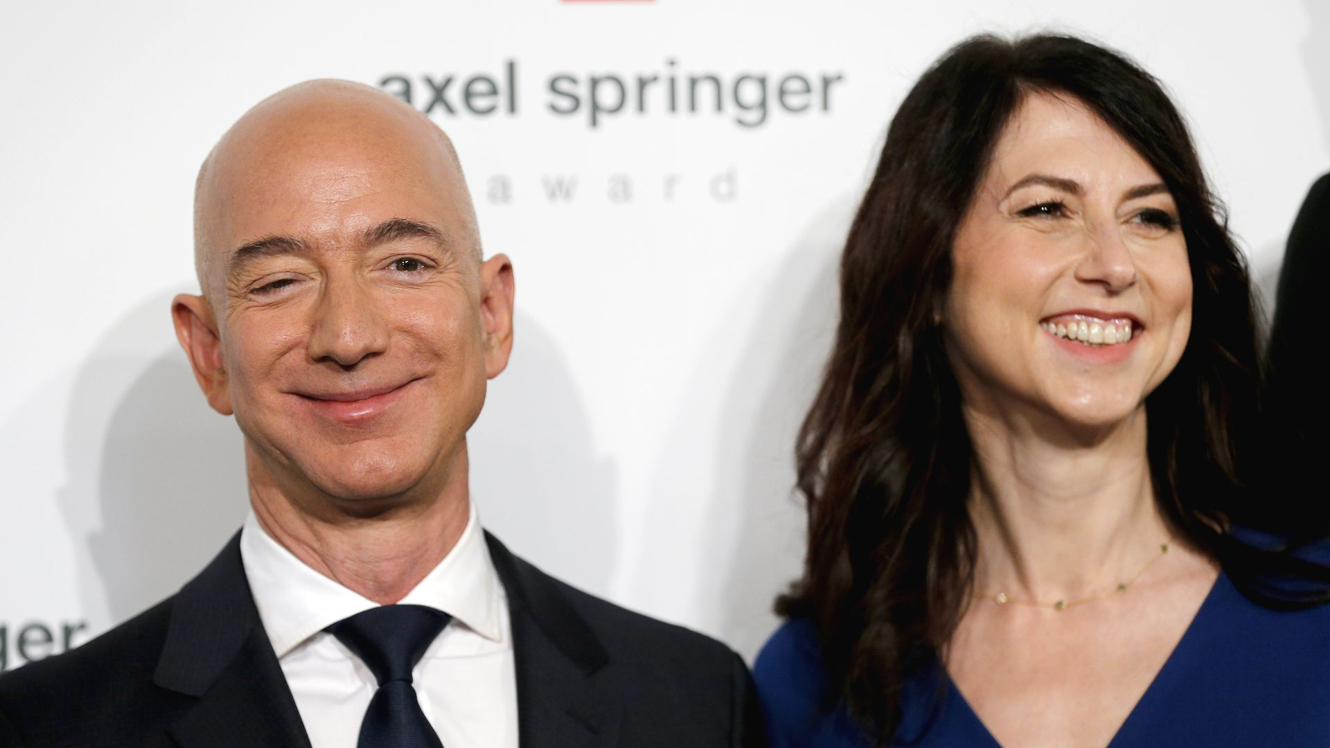 Jeff Bezos stands next to his wife MacKenzie