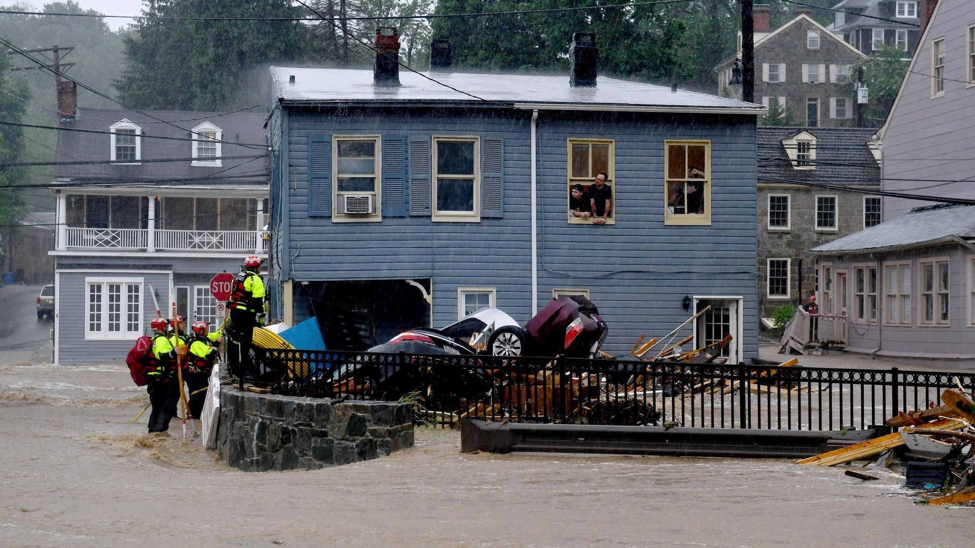 Rescuers work to free people trapped upstairs from a record store during torrential rain that caused flash floods along Main Street May 27, 2018 in Ellicott City, Maryland.
