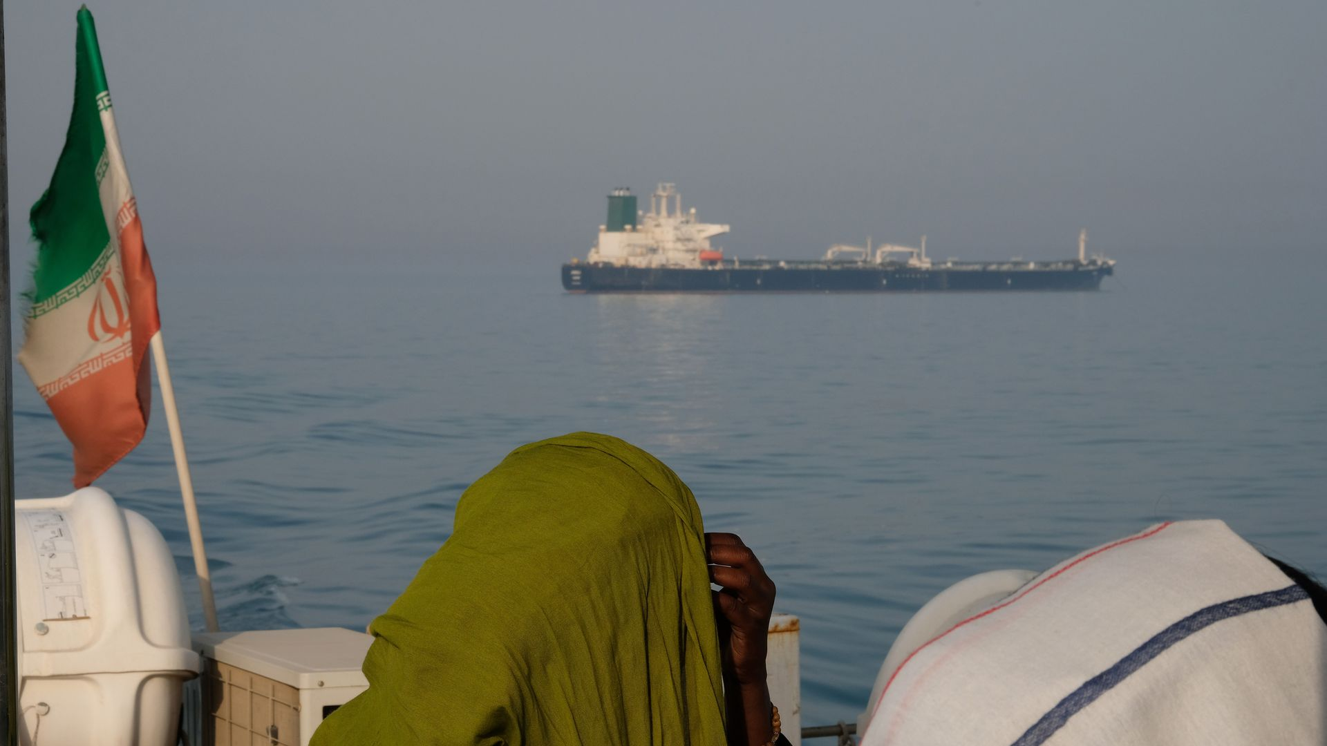 Photo of oil tanker in Hormuz Strait taken from a boat with the Iranian flag flying on it