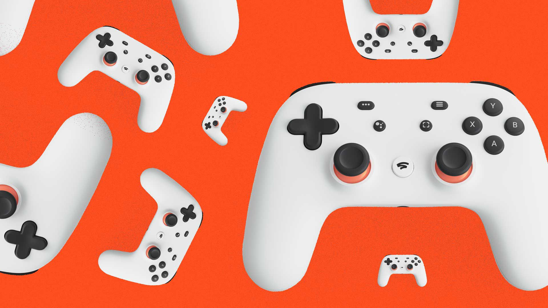Multiple images of Google's game controller against an orange background