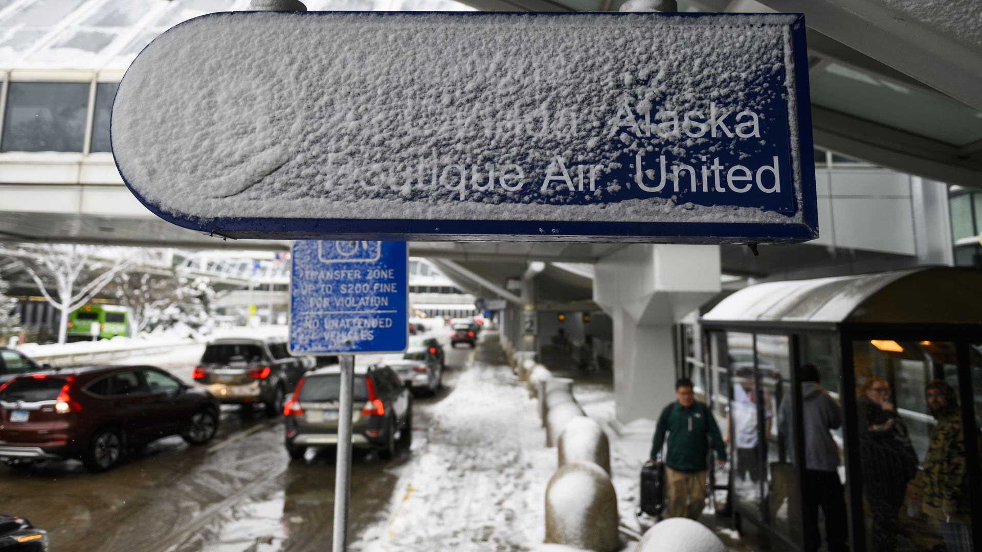 Signage outside Minneapolis-St. Paul International Airport is caked in snow after a blizzard struck overnight on November 27, 2019 in Bloomington, Minnesota.