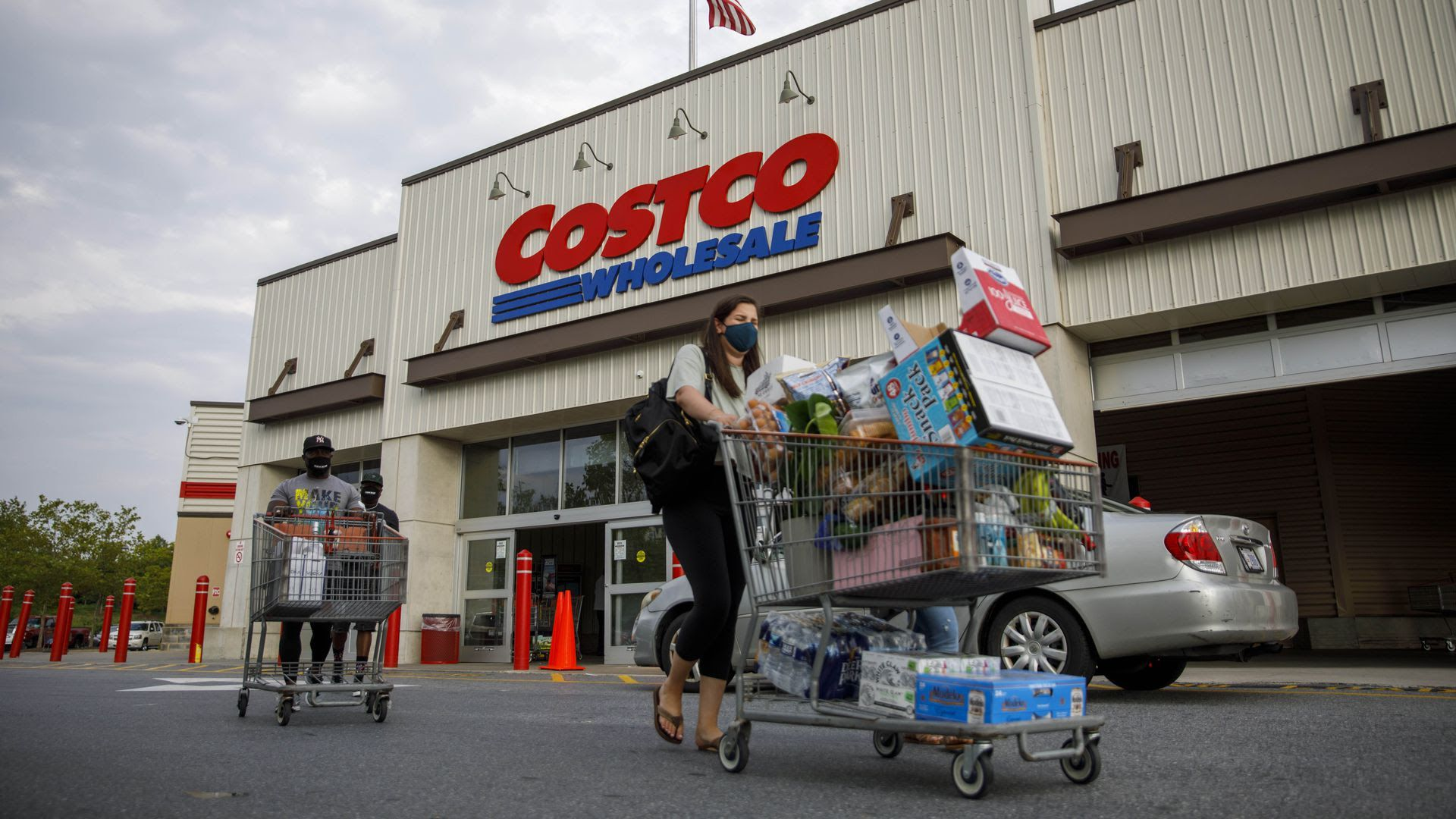 Shoppers exit a Costco in Washington, D.C.