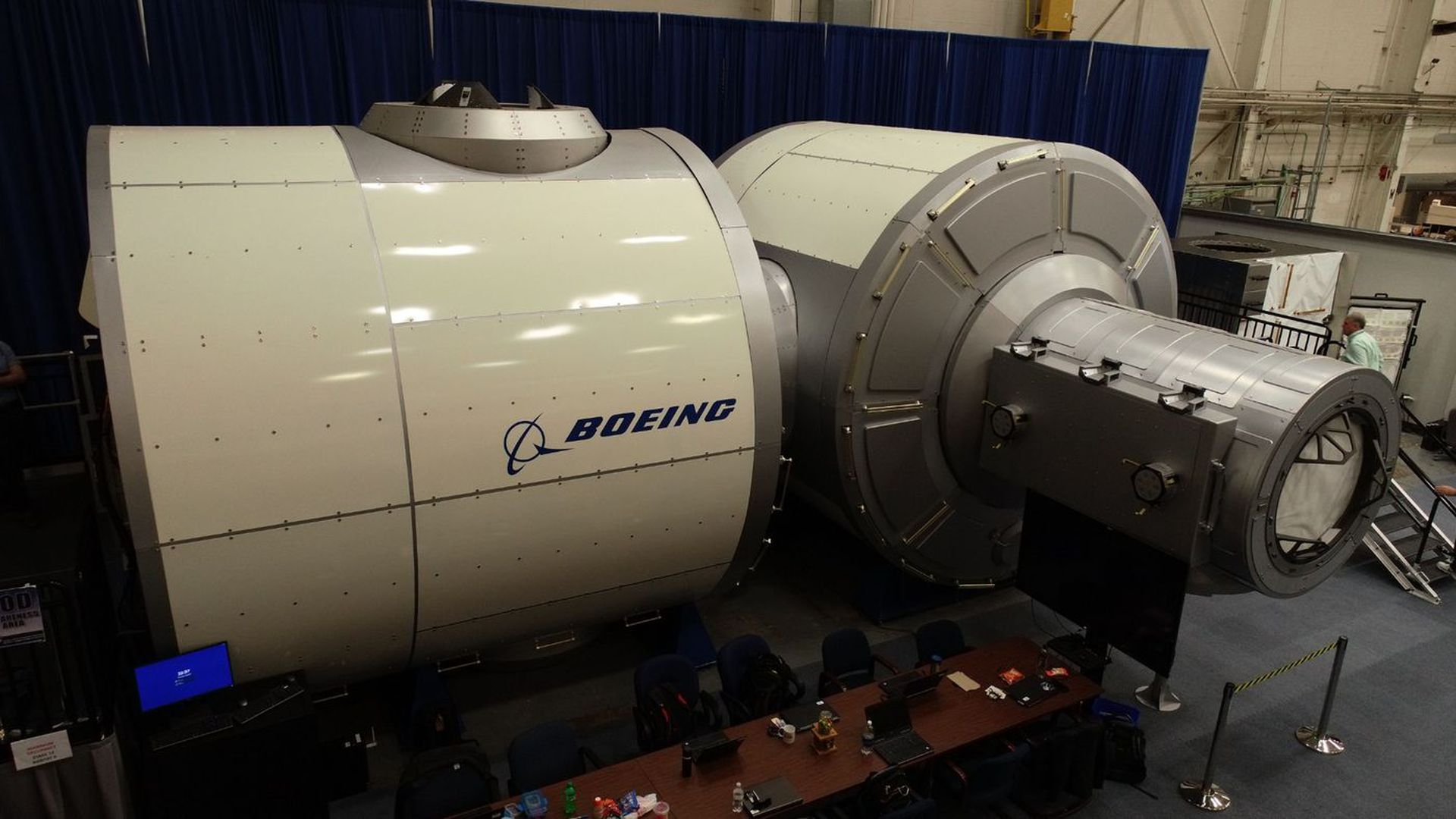 In this image, the Boeing logo is seen on the side of a large white circular gateway demonstrator.