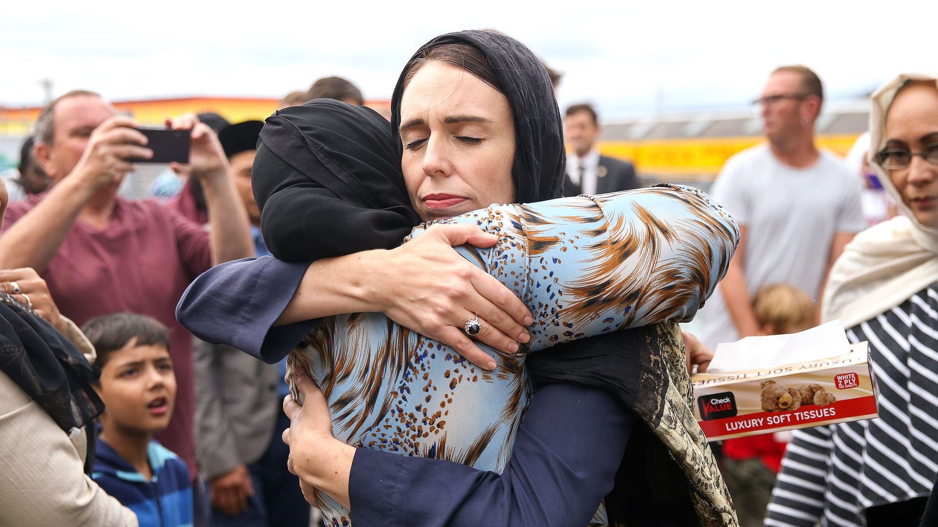 Prime Minister Jacinda Ardern hugs a woman at Kilbirnie Mosque in Wellington, New Zealand, Sunday.