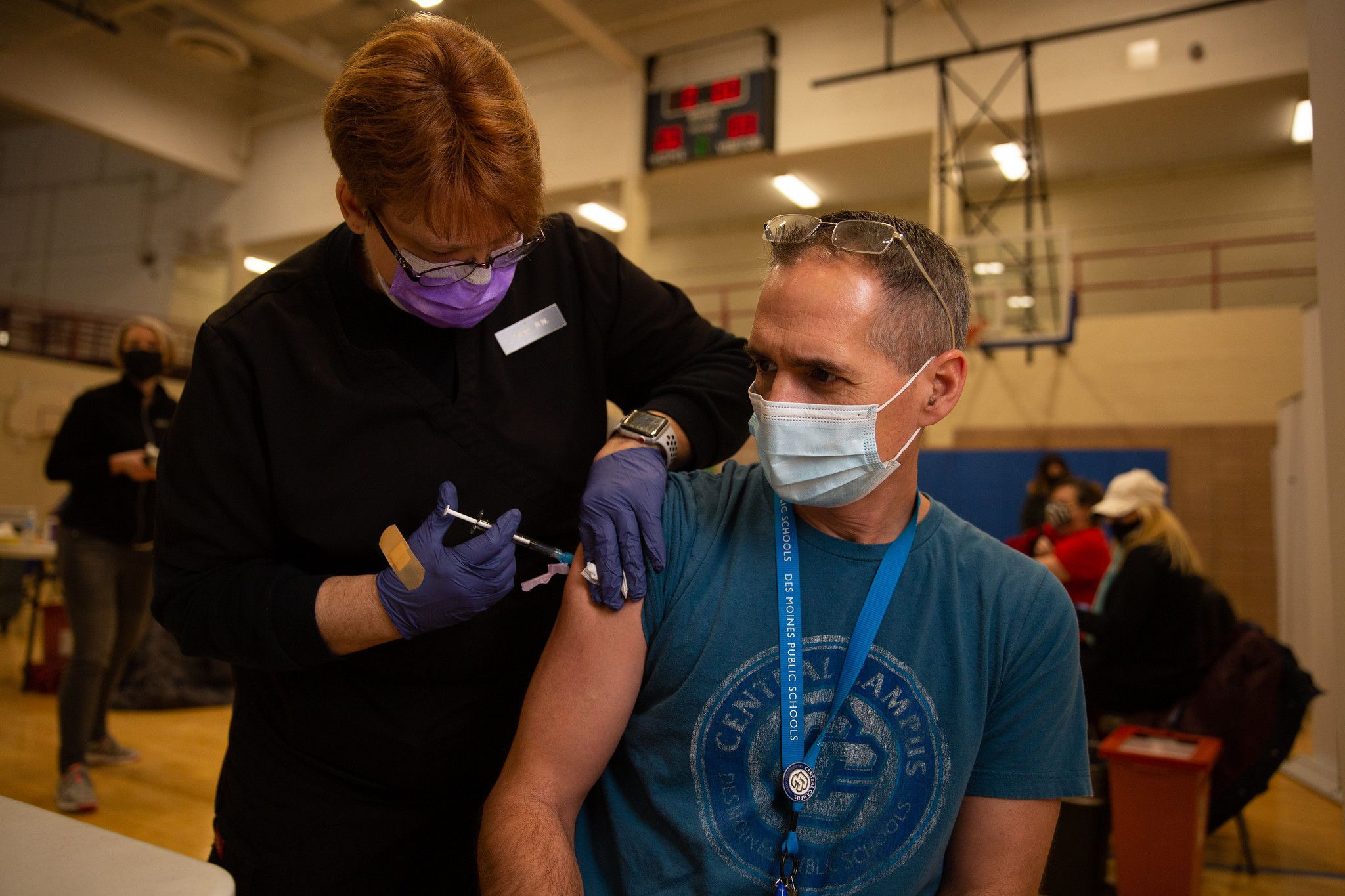 Picture of a man getting vaccinated