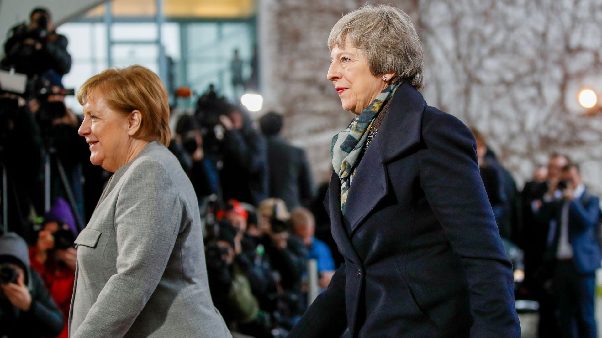 German Chancellor Angela Merkel (L) precedes British Prime Minister Theresa May after greeting her at the Chancellery in Berlin, on December 11, 2018, prior bilateral talks.