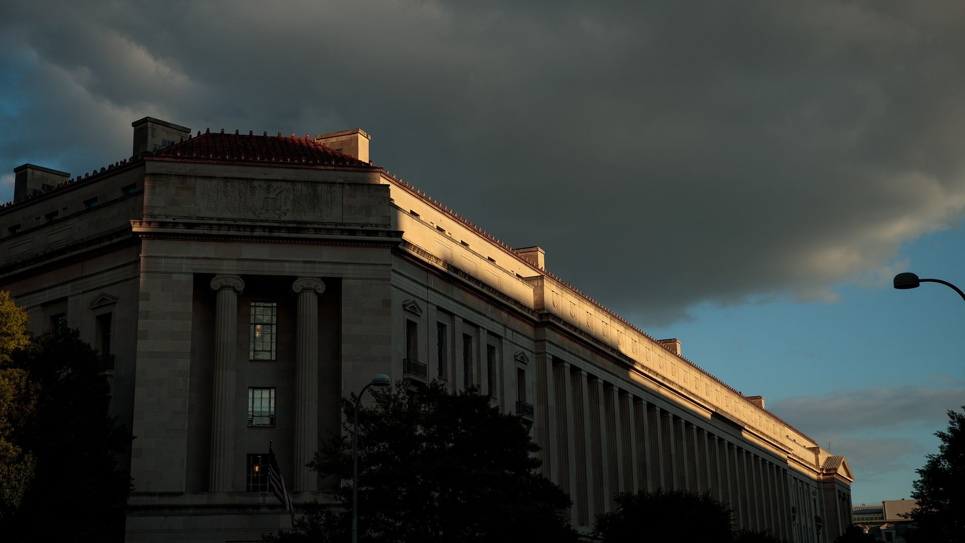 The headquarters of the Department of Justice under a dark sky