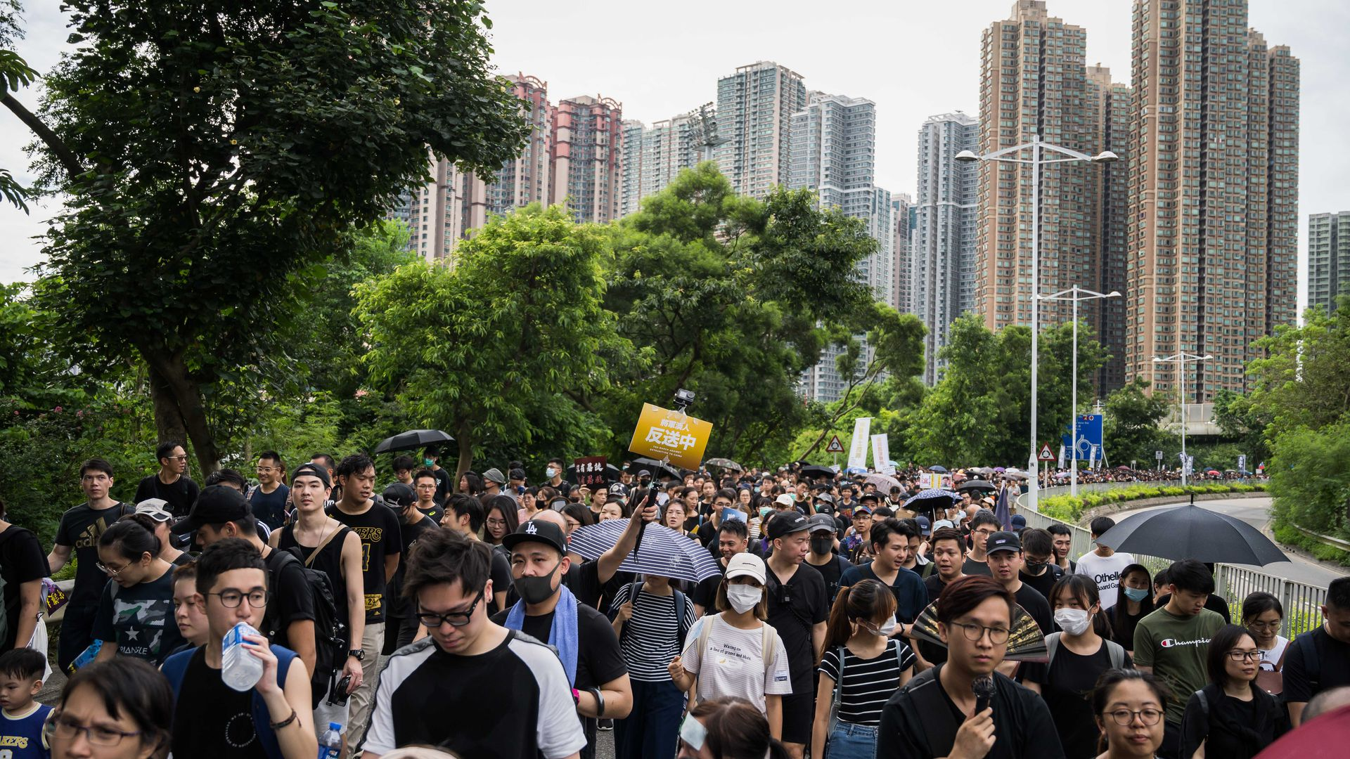 : Demonstrators march during a protest in the Tseung Kwan O district on Aug. 04, 2019 in Hong Kong