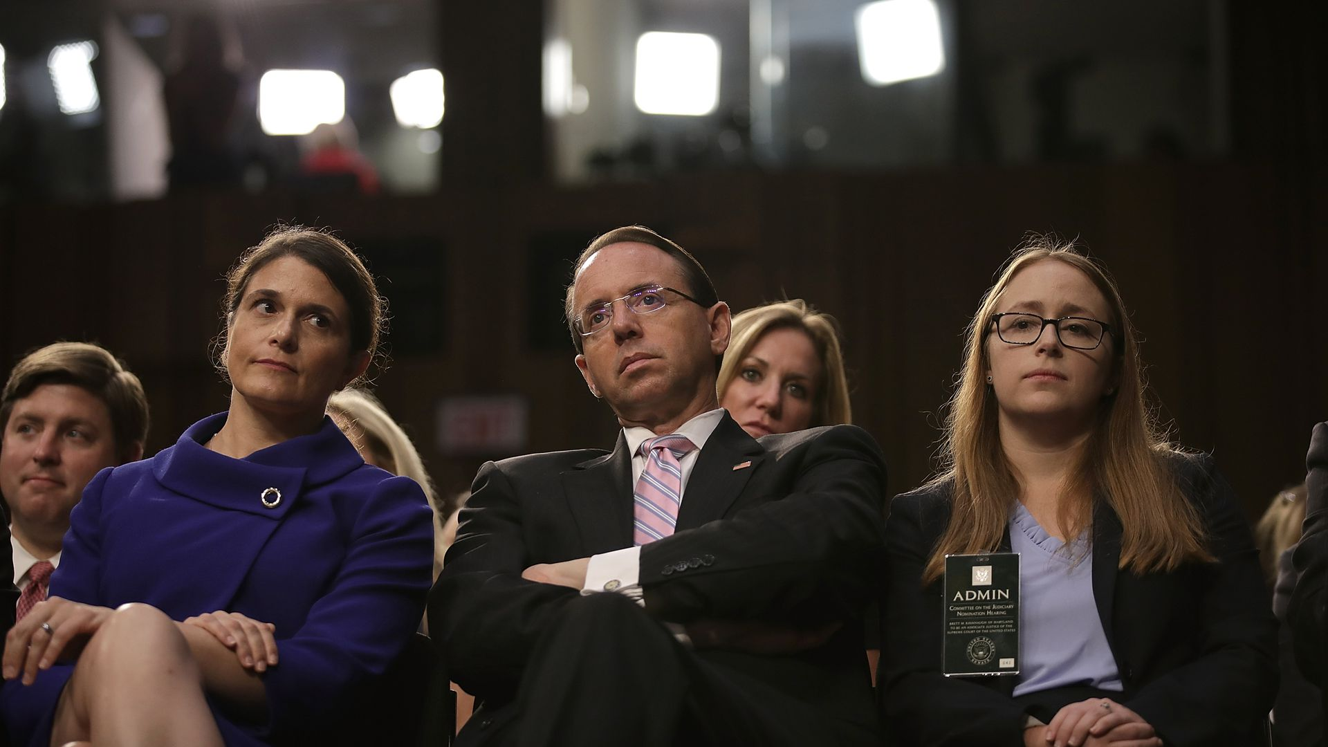 Deputy Attorney General Rod Rosenstein sitting in a hearing with his arms crossed leaning backwards.