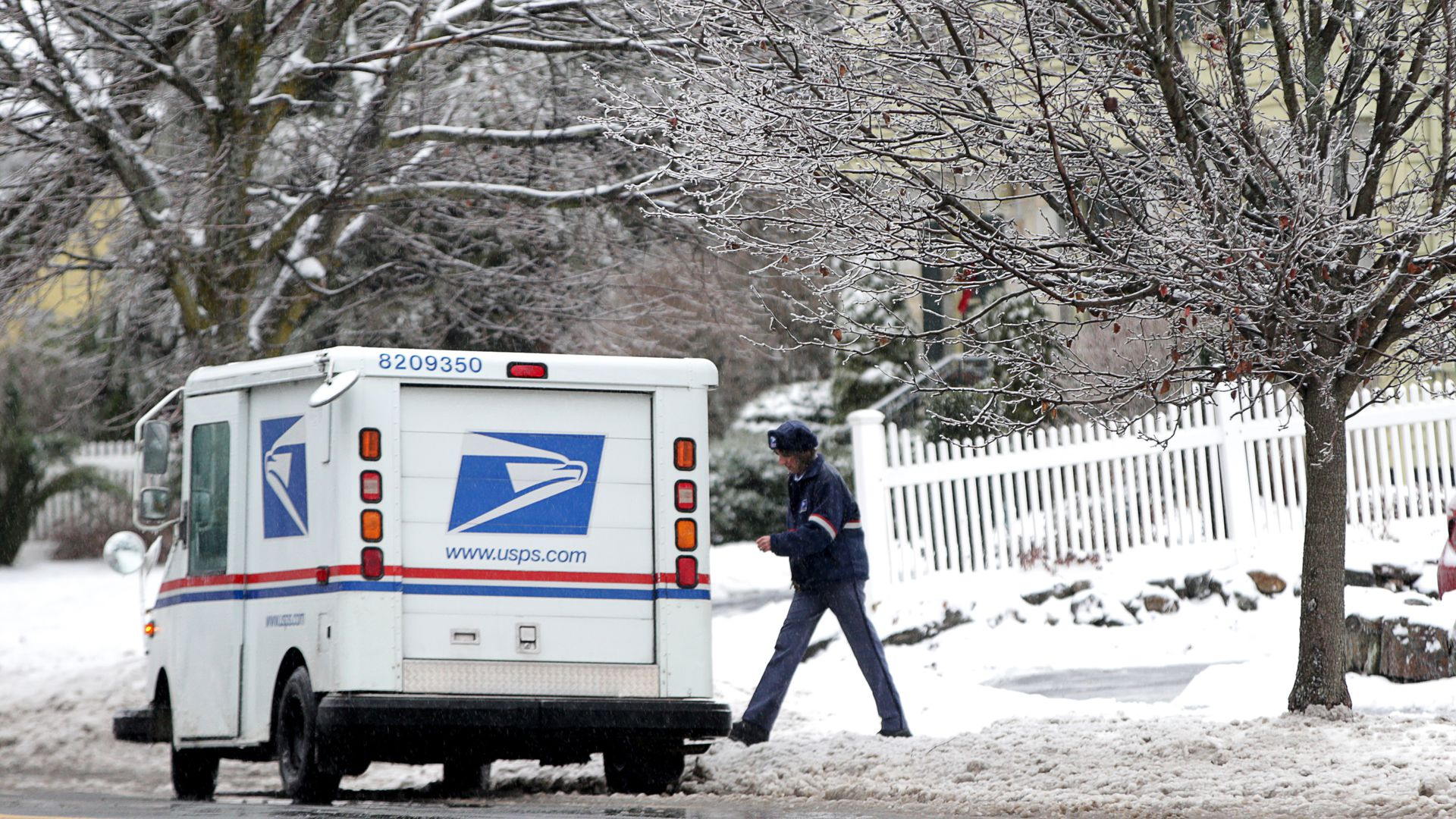 A United States Postal Service mail carrier.