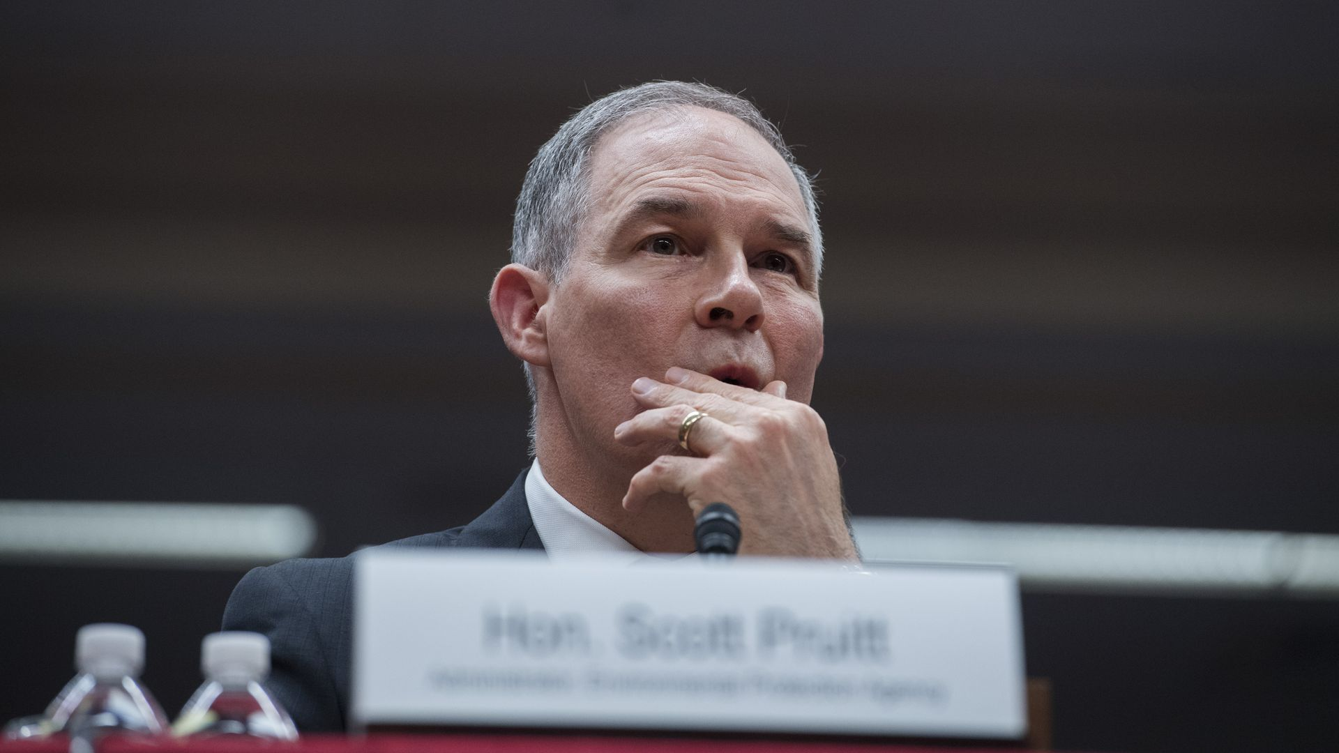 In this image, Scott Pruitt rubs his face at a hearing.
