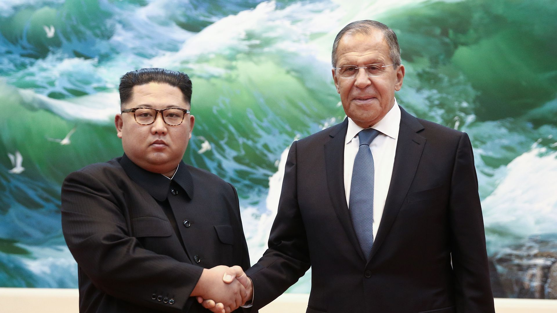 Kim Jong Un and Sergei Lavrov shaking hands