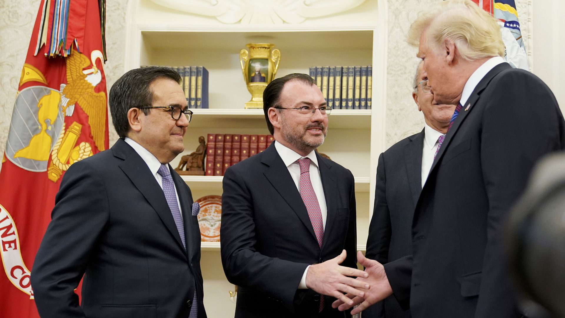 US President Donald Trump shakes hands with Mexico's Foreign Minister Luis Videgaray Caso as he arrives to speak on trade in the Oval Office.