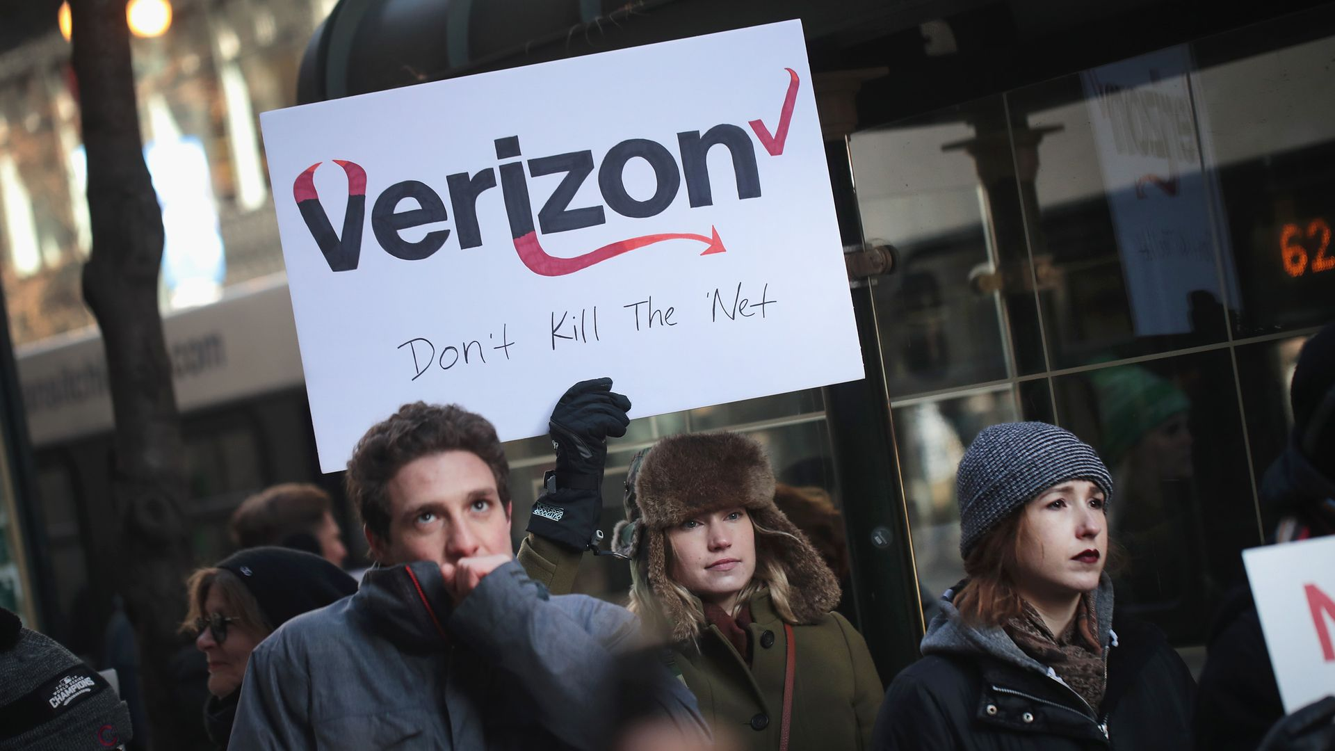 Demonstrators, supporting net neutrality, protest a plan by the FCC to repeal restrictions on internet service providers