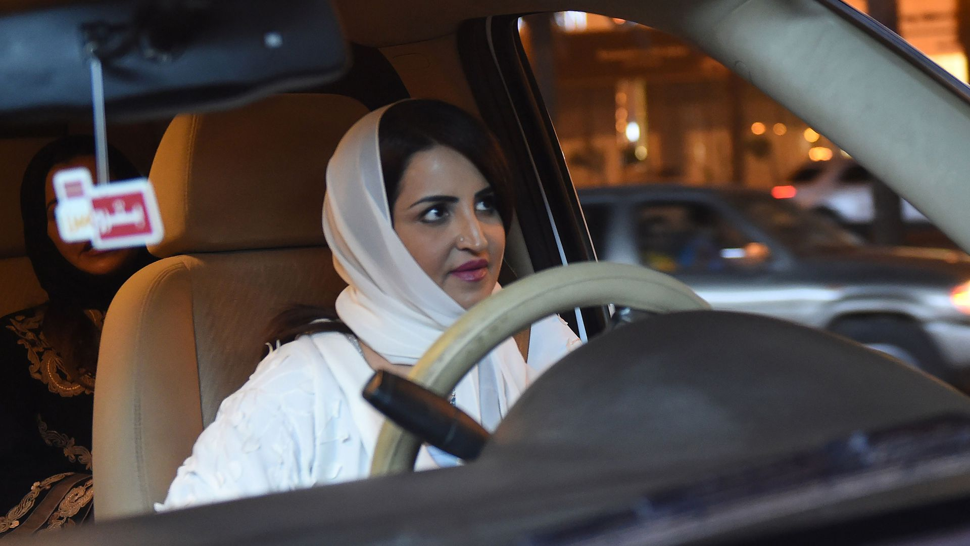 A Saudi woman behind the wheel of a car.