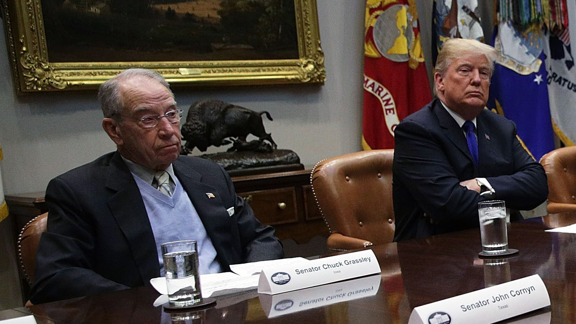 Donald Trump and Chuck Grassley seated next to each other.
