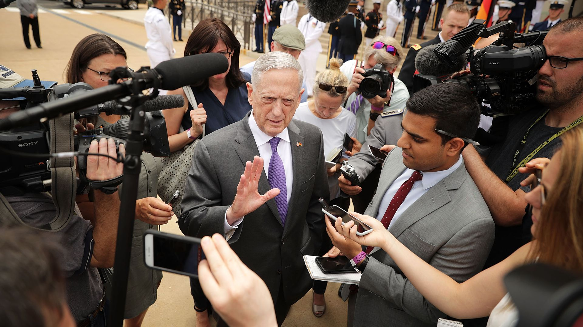James Mattis surrounded by press.