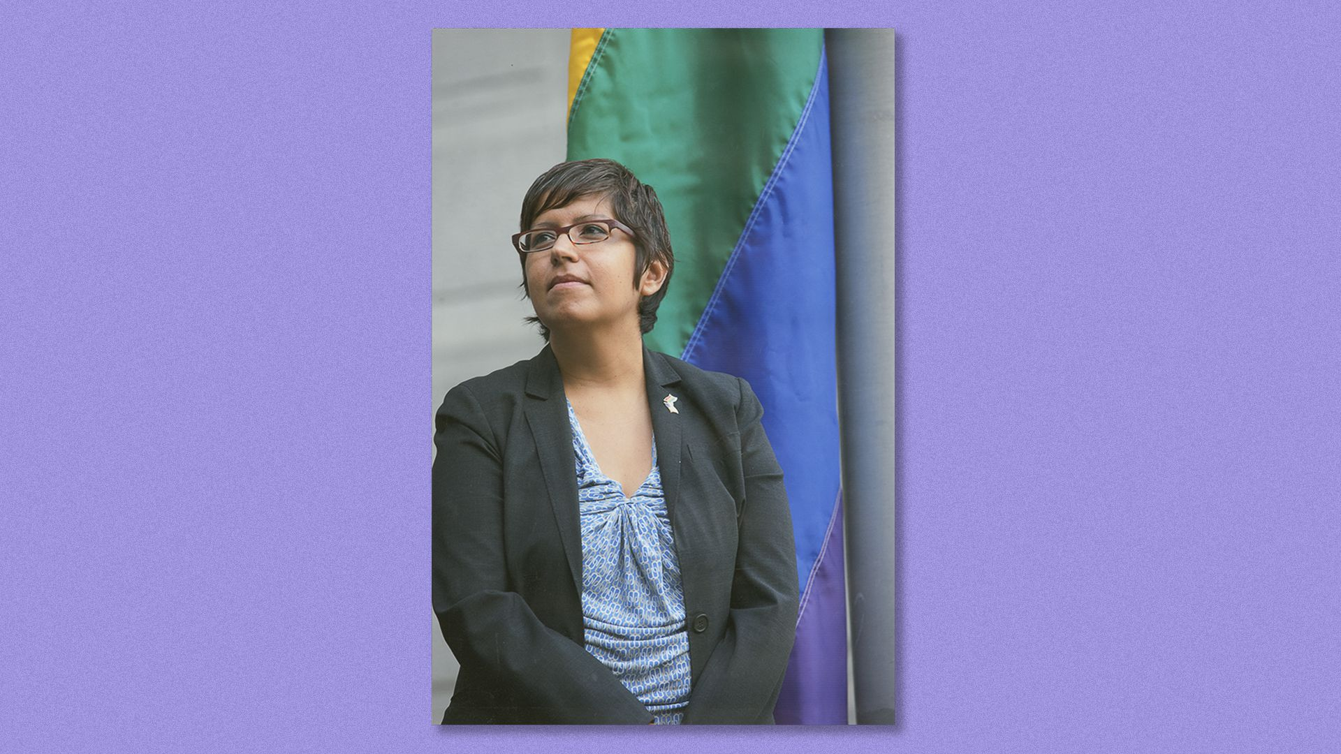 Gloria Casarez in front of the rainbow flag at City Hall the first year it was flown for LGBT History Month.