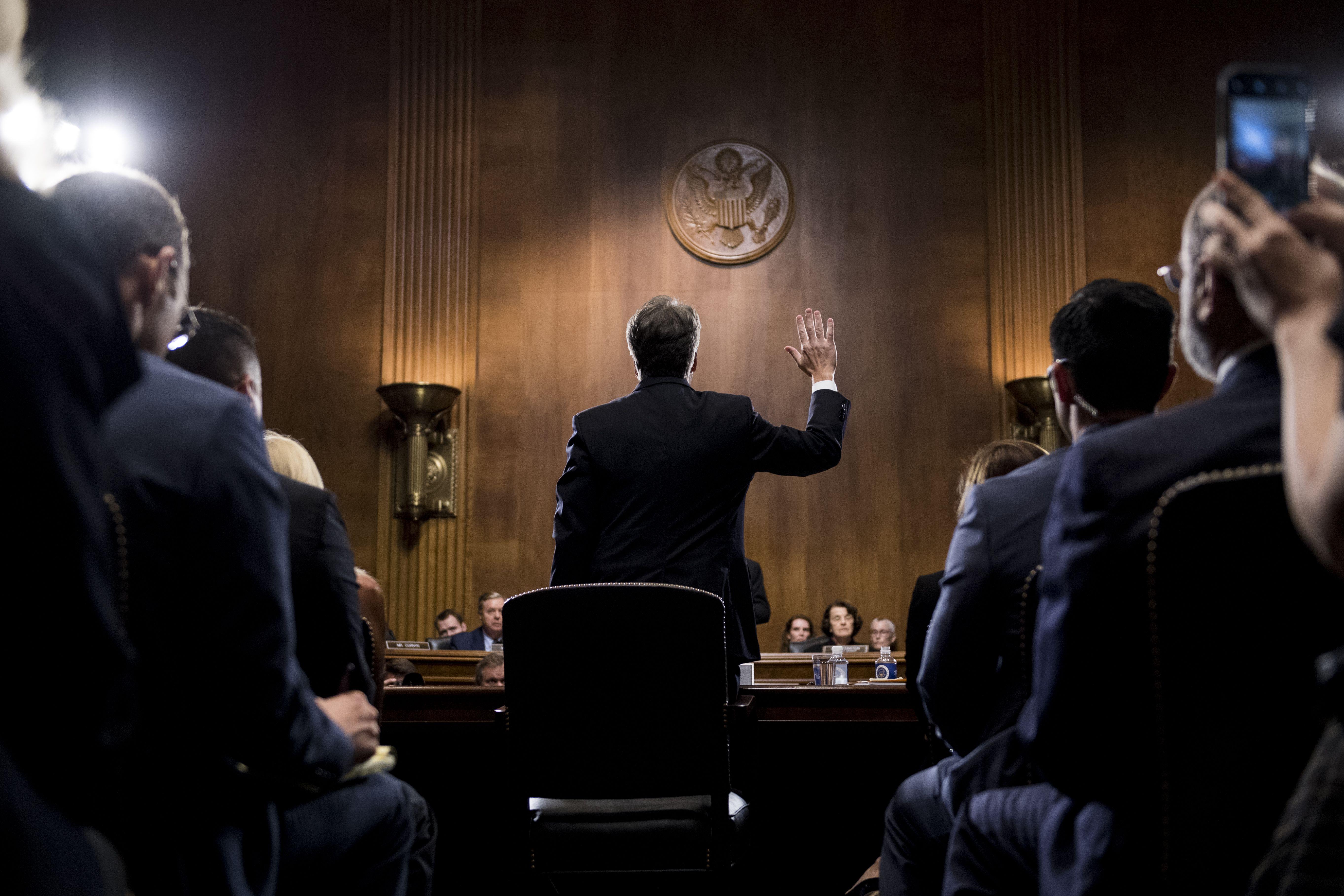 Kavanaugh sworn in before testifying. Photo: Tom Williams-Pool/Getty Images