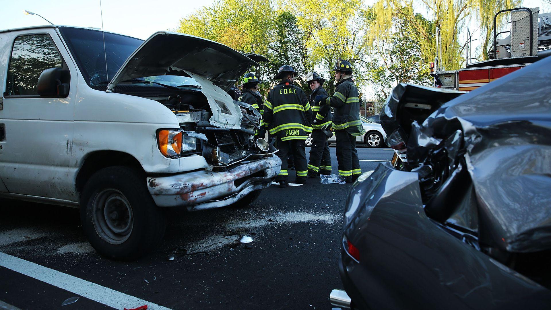 Cars damaged post-collision.