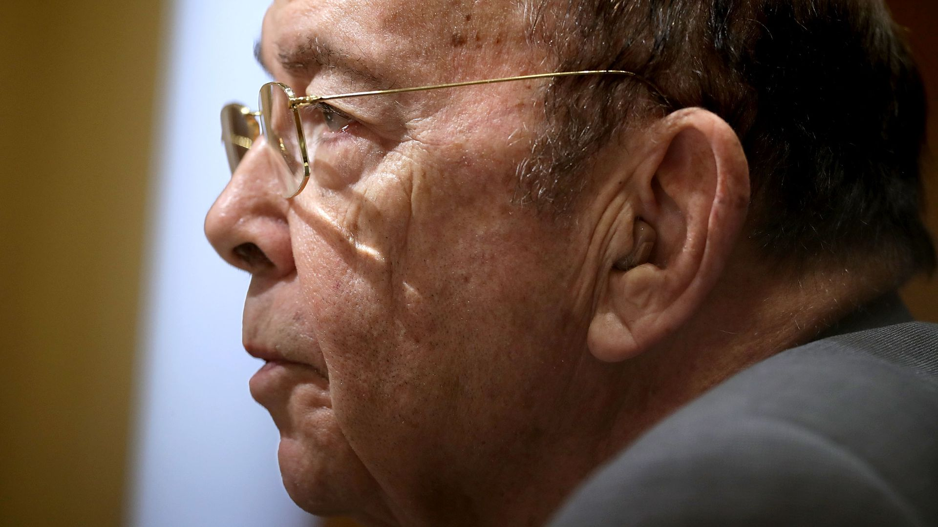 Close up of wilbur ross's face. Bald white man with glasses.
