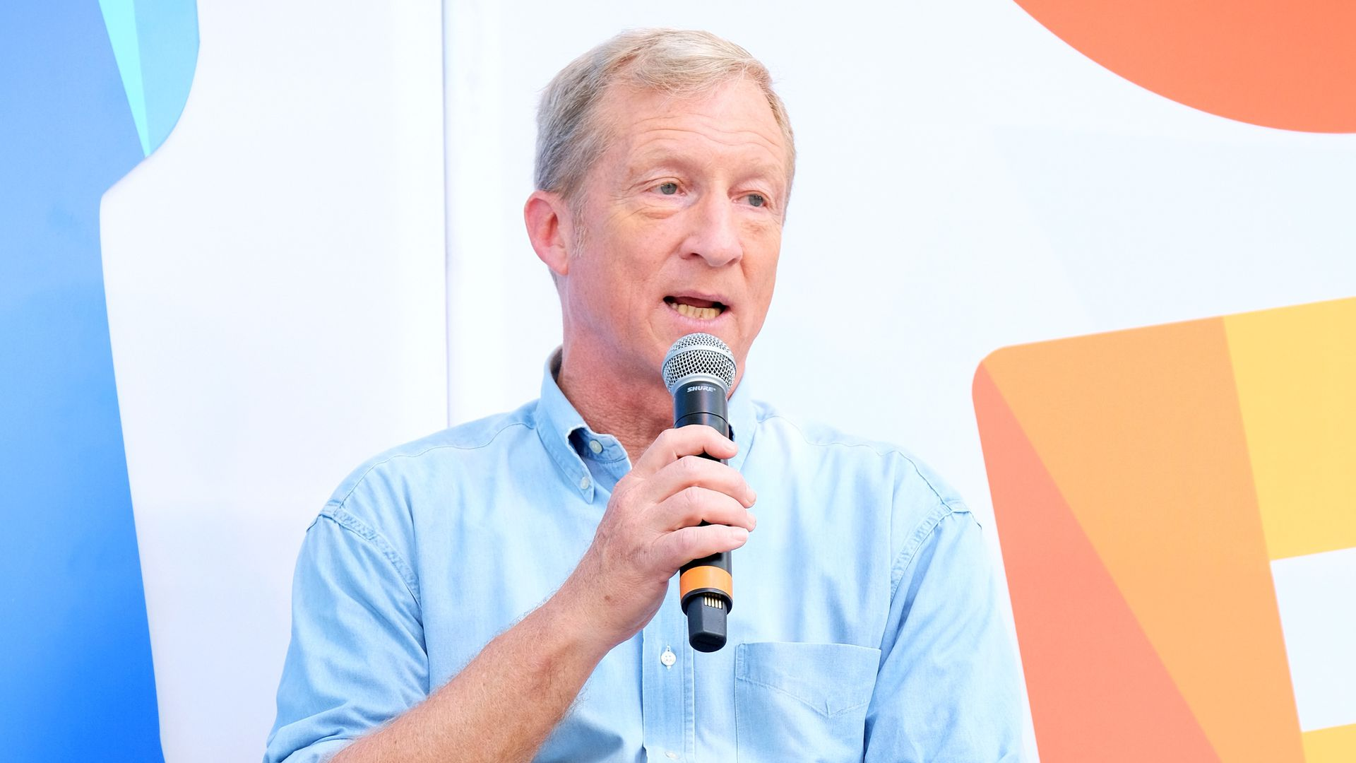 Tom Steyer speaks onstage at a festival