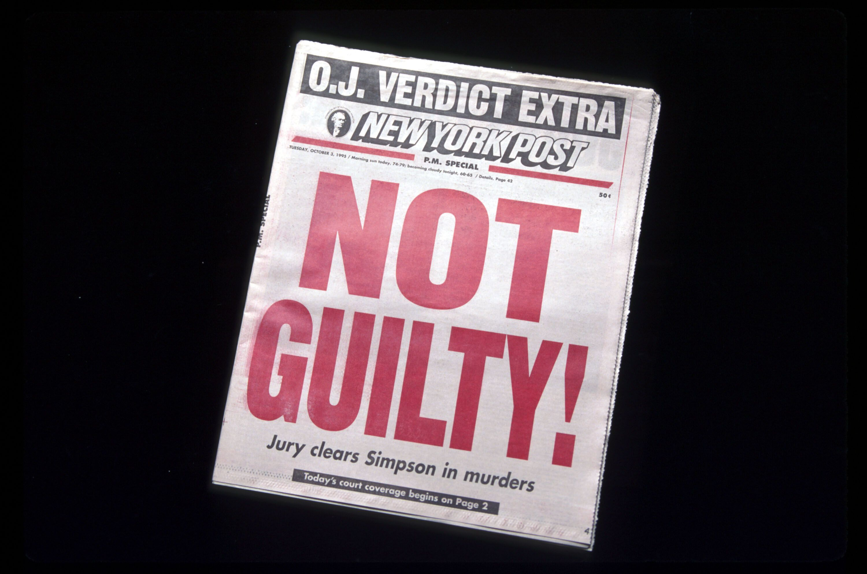 """Newspaper cover that reads """"Not Guilty!"""""""