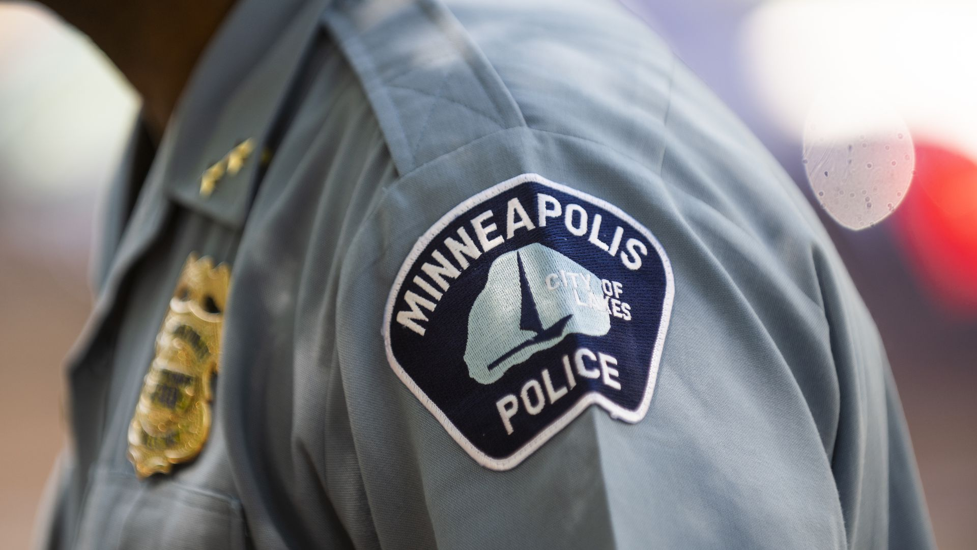 Picture of a police officer's shoulder that shows the Minneapolis police department seal