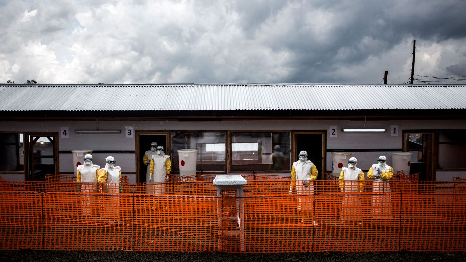 Health workers are seen inside the red zone at a newly build MSF (Doctors Without Borders) supported ebola treatment centre in November in Bunia, DRC.