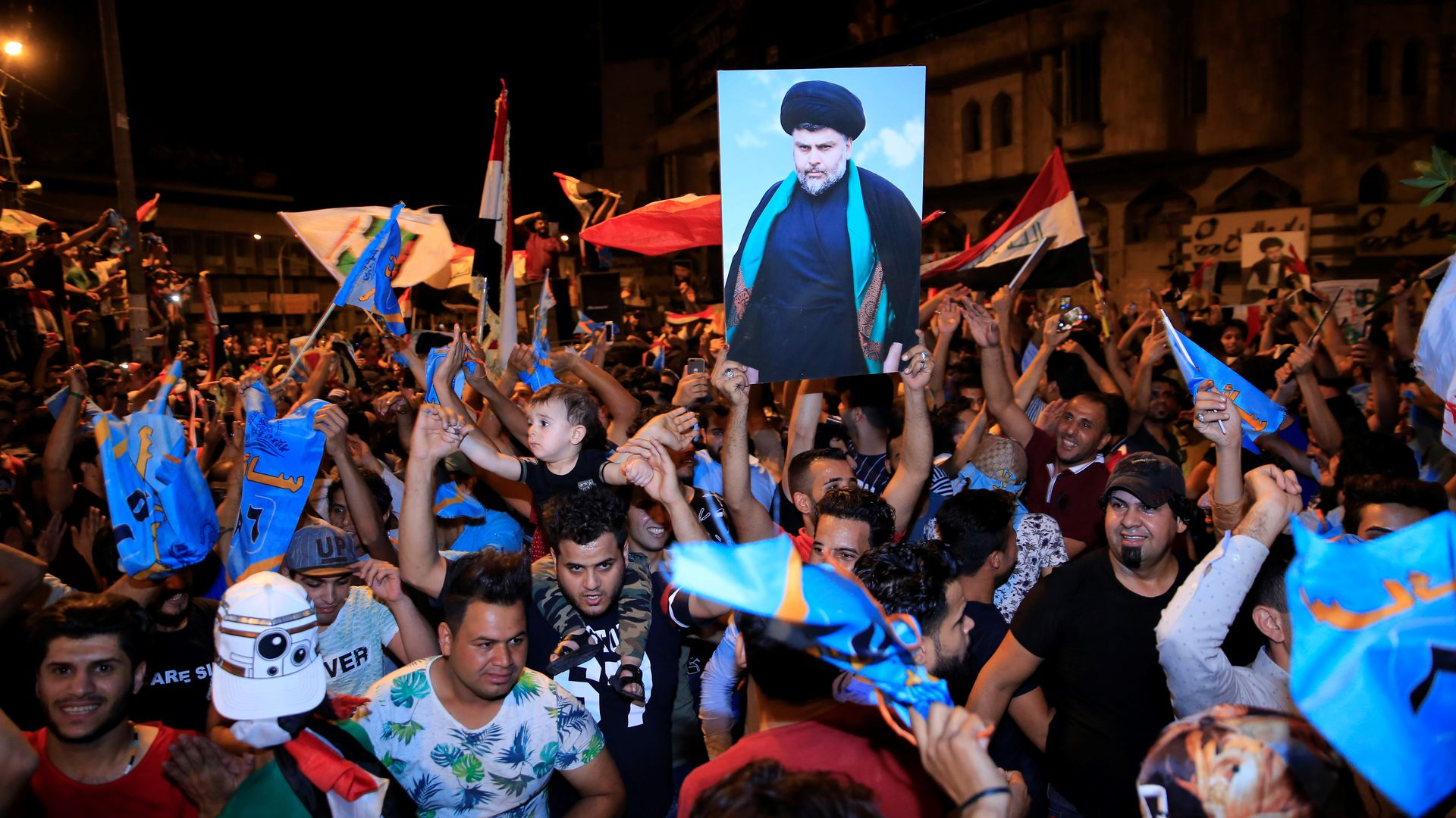 BAGHDAD, IRAQ - MAY 13: Supporters of Iraqi Shiite cleric Moqtada al-Sadr celebrate the results of the parliamentary election at the Tahrir Square, Baghdad, Iraq.