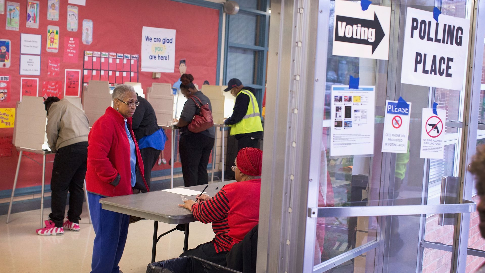 Residents cast their votes at a polling place