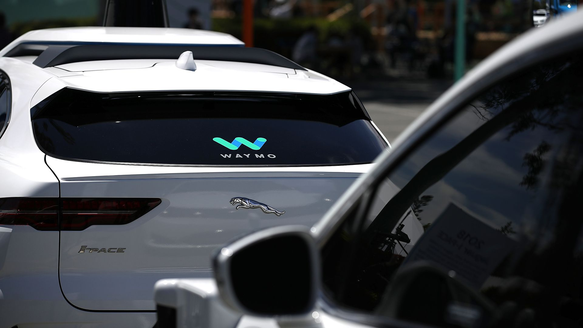 a Waymo SUV on the road