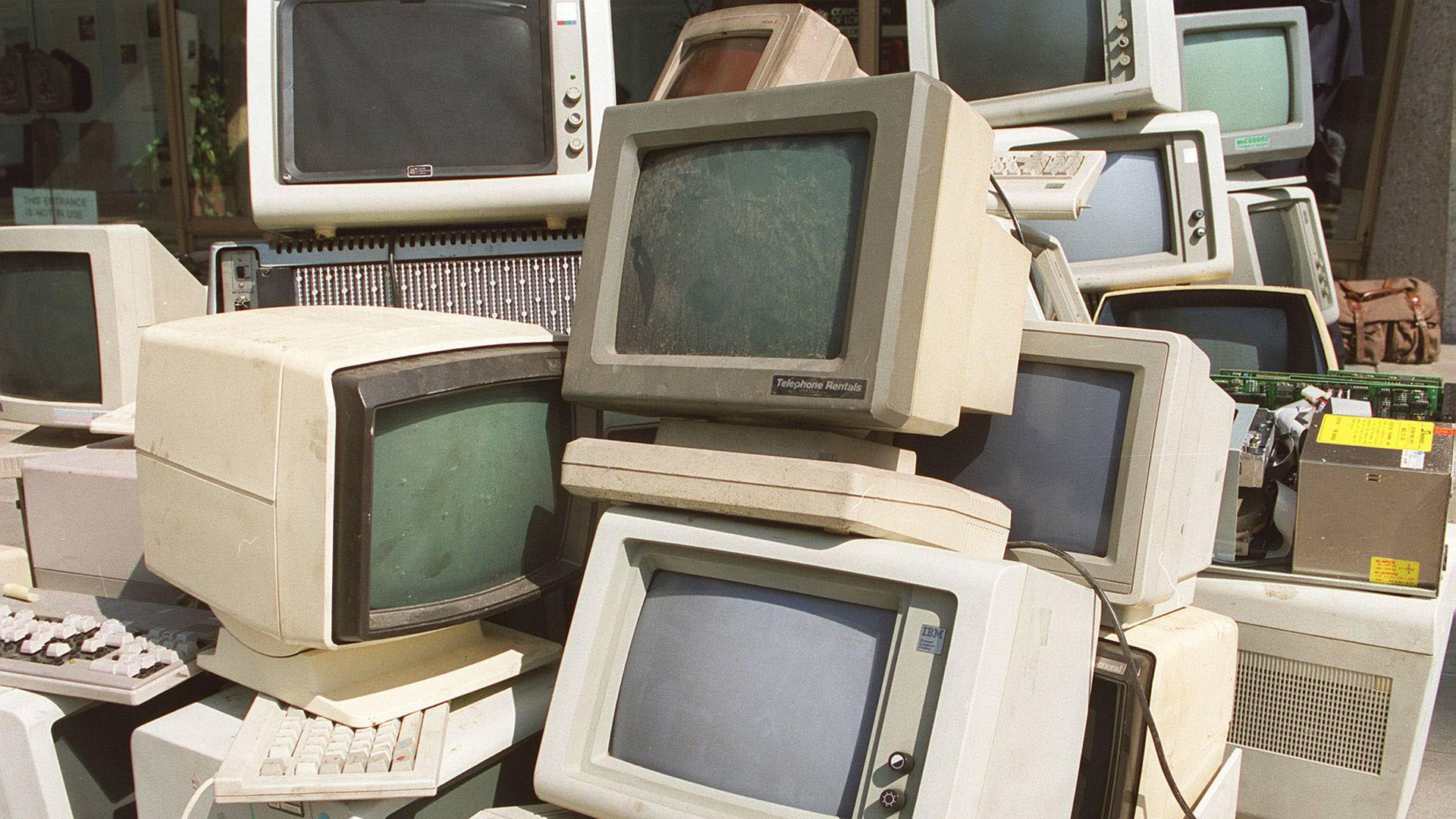 A heap of old computer monitors from the '80s ands '90s
