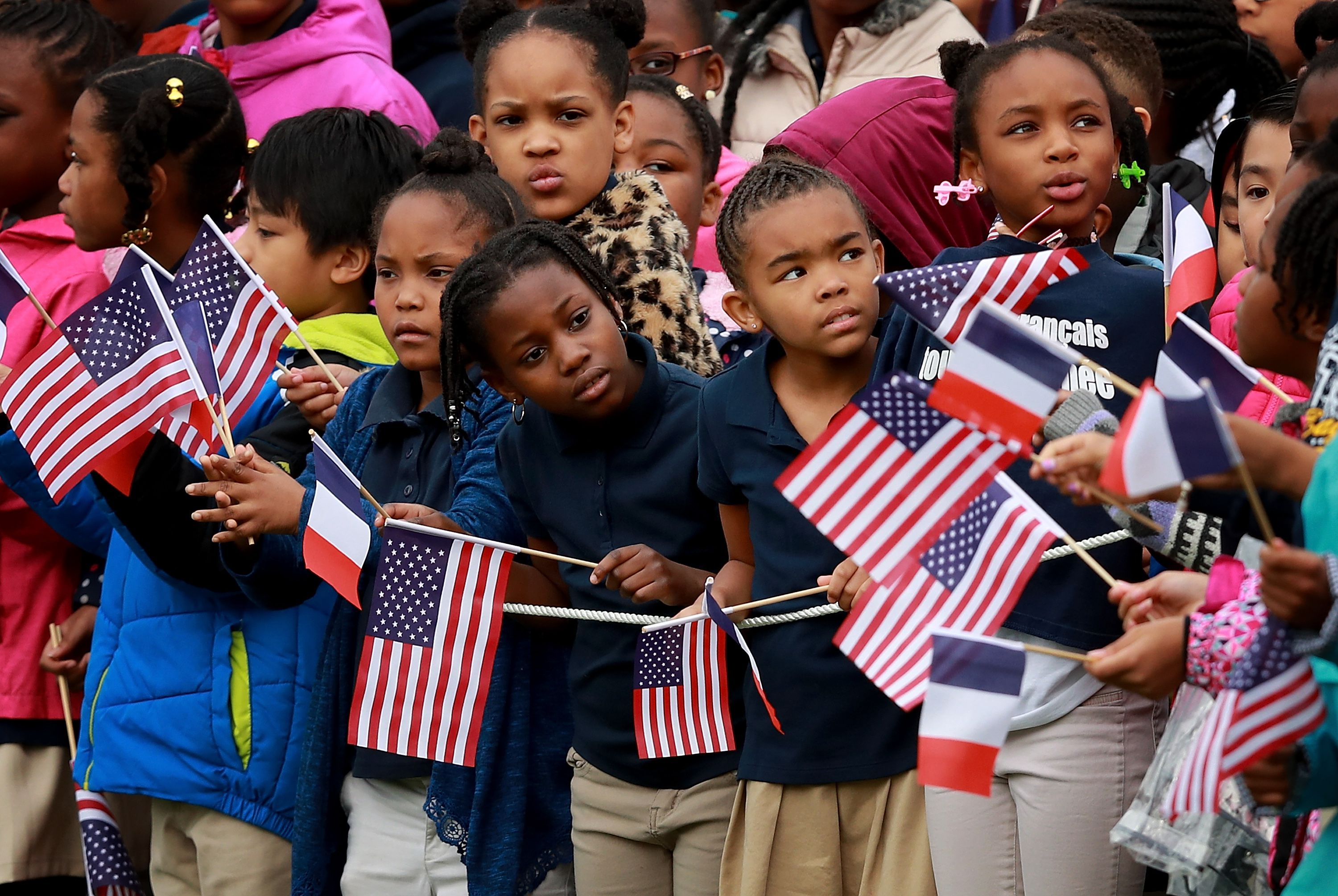 Children waving American flags