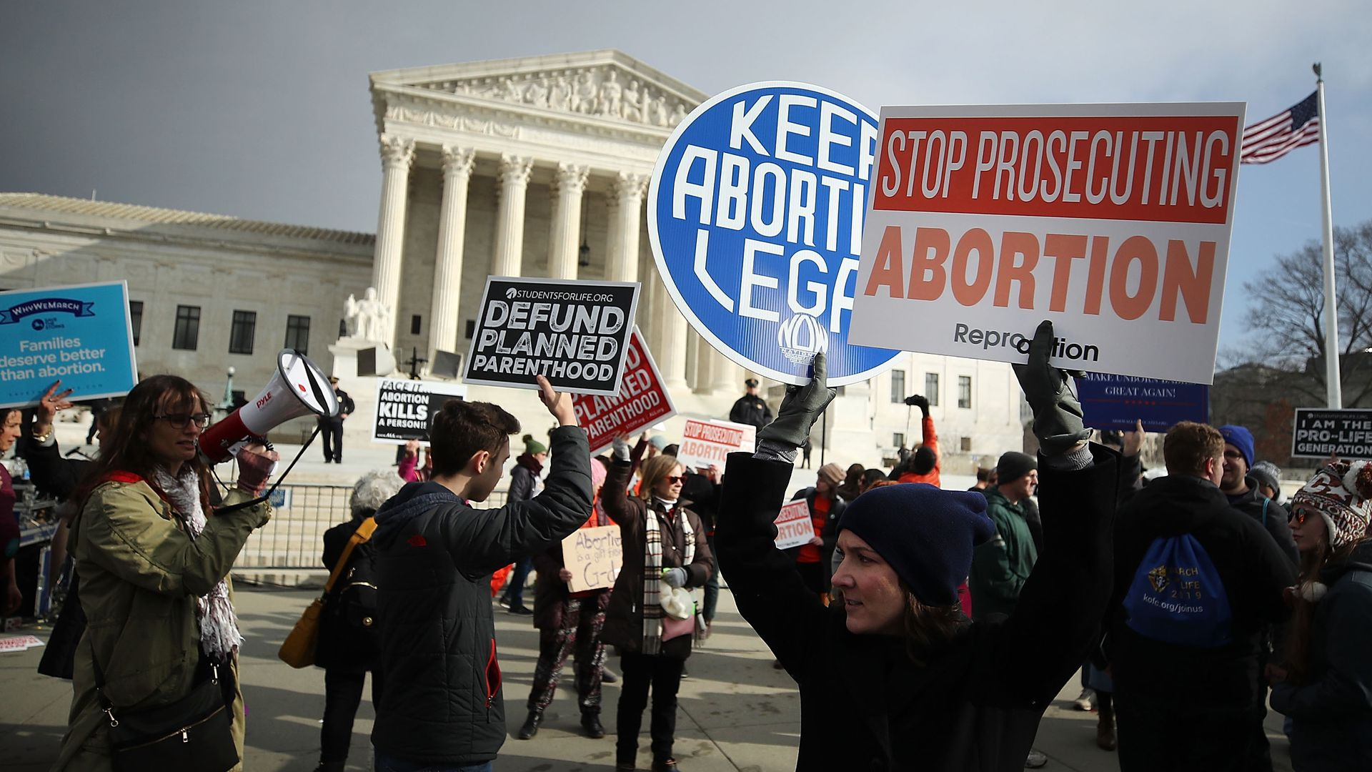 Supporters of legal access to abortion, as well as anti-abortion activists, rally outside the Supreme Court.